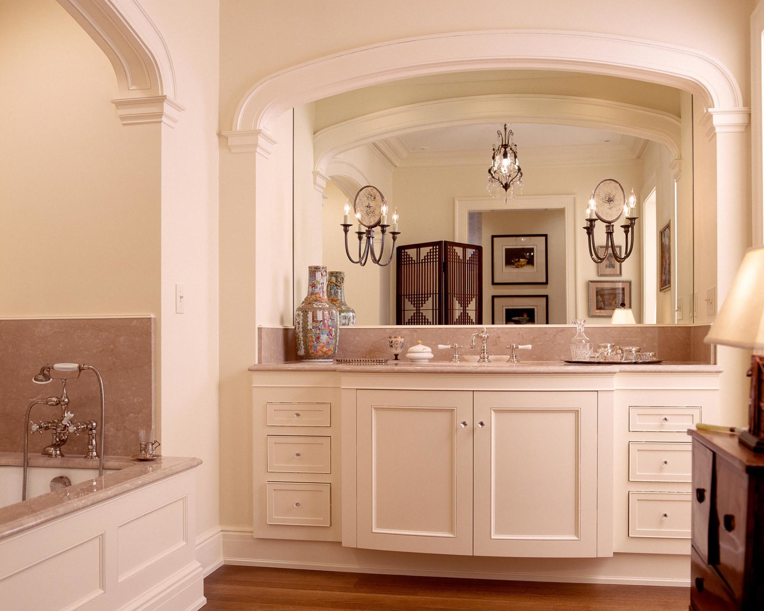House interior with white walls, white cabinet and large mirror