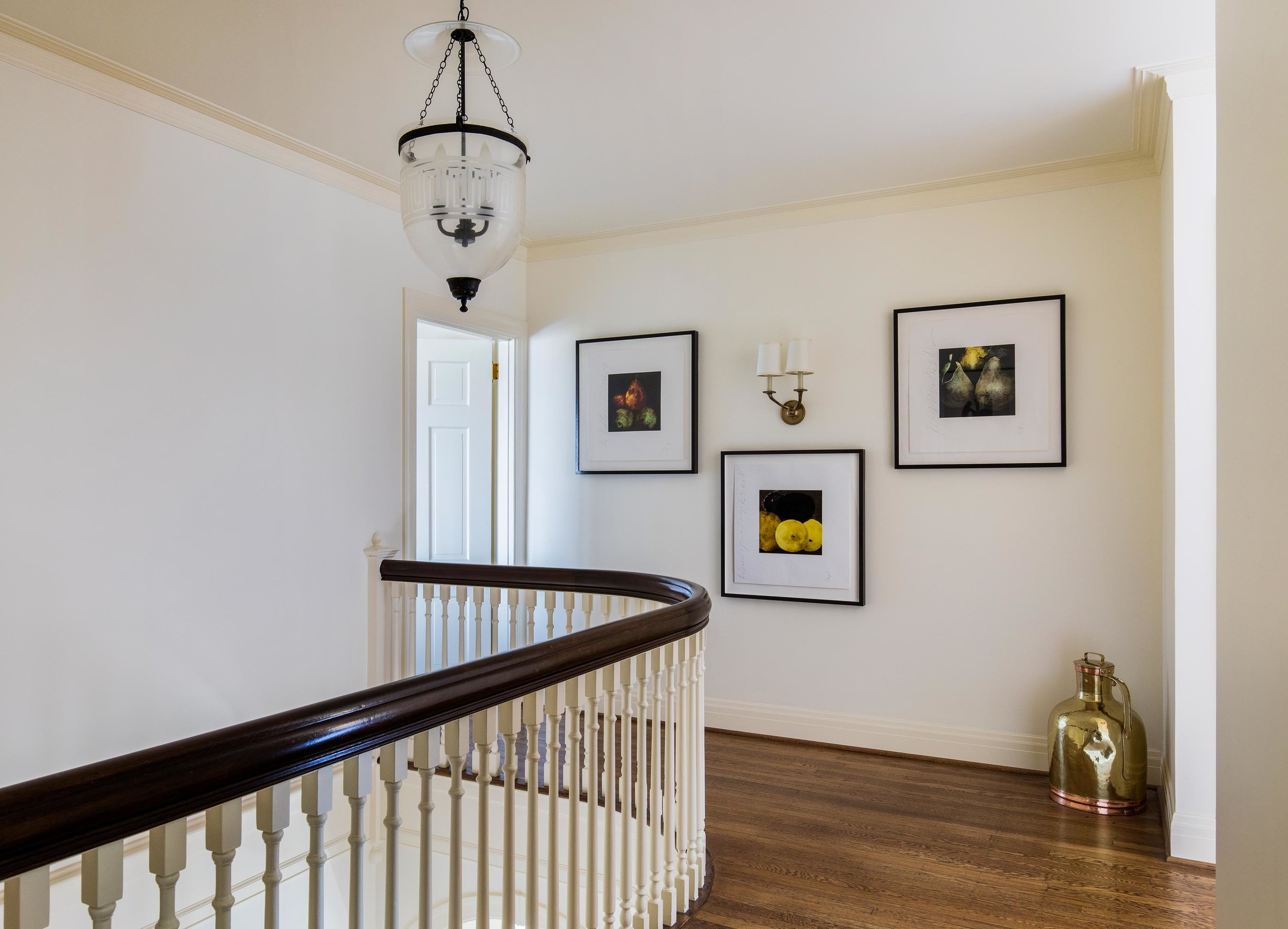 Second floor house interior with hardwood floor and wooden railings
