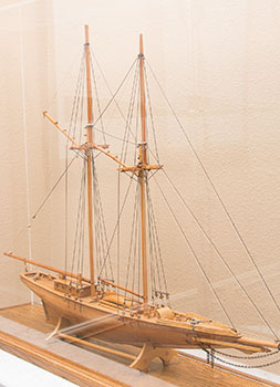 """There was a time when intrepid adventurers set out to conquer the world. That spirit is still alive in the US and particularly here in California. At Putney, we believe charting a financial course is critical for all.  The model above is on display in the Putney conference room. Several Putney principals are avid sailors and this ship is world famous. The Bluenose was a Canadian fishing and racing schooner from Nova Scotia built in 1921. A celebrated racing ship and fishing vessel, Bluenose, under the command of Angus Walters, became a provincial icon for Nova Scotia and an important Canadian symbol in the 1930s. The name """"bluenose"""" originated as a nickname for Nova Scotians from as early as the late 18th century. The Bluenose has appeared on Canadian stamps, is currently on the Canadian dime and on the license plate of the province of Nova Scotia. ( Ray Lent collection )"""