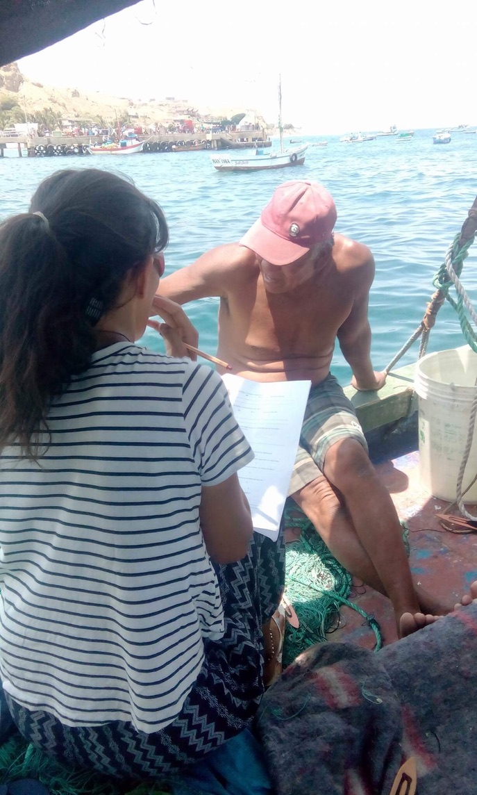 Lucie hard at work with local fisherman in Peru. Photo Lucie Guirkinger