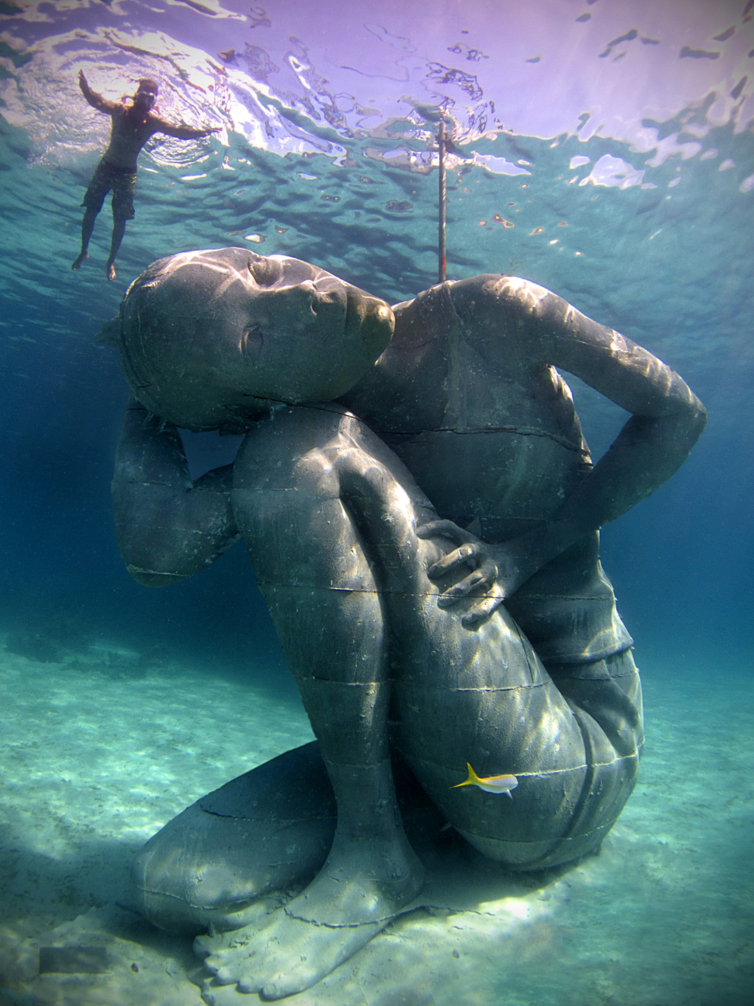 Image from https://www.thisiscolossal.com/2014/10/ocean-atlas-a-massive-submerged-girl-carries-the-weight-of-the-ocean/