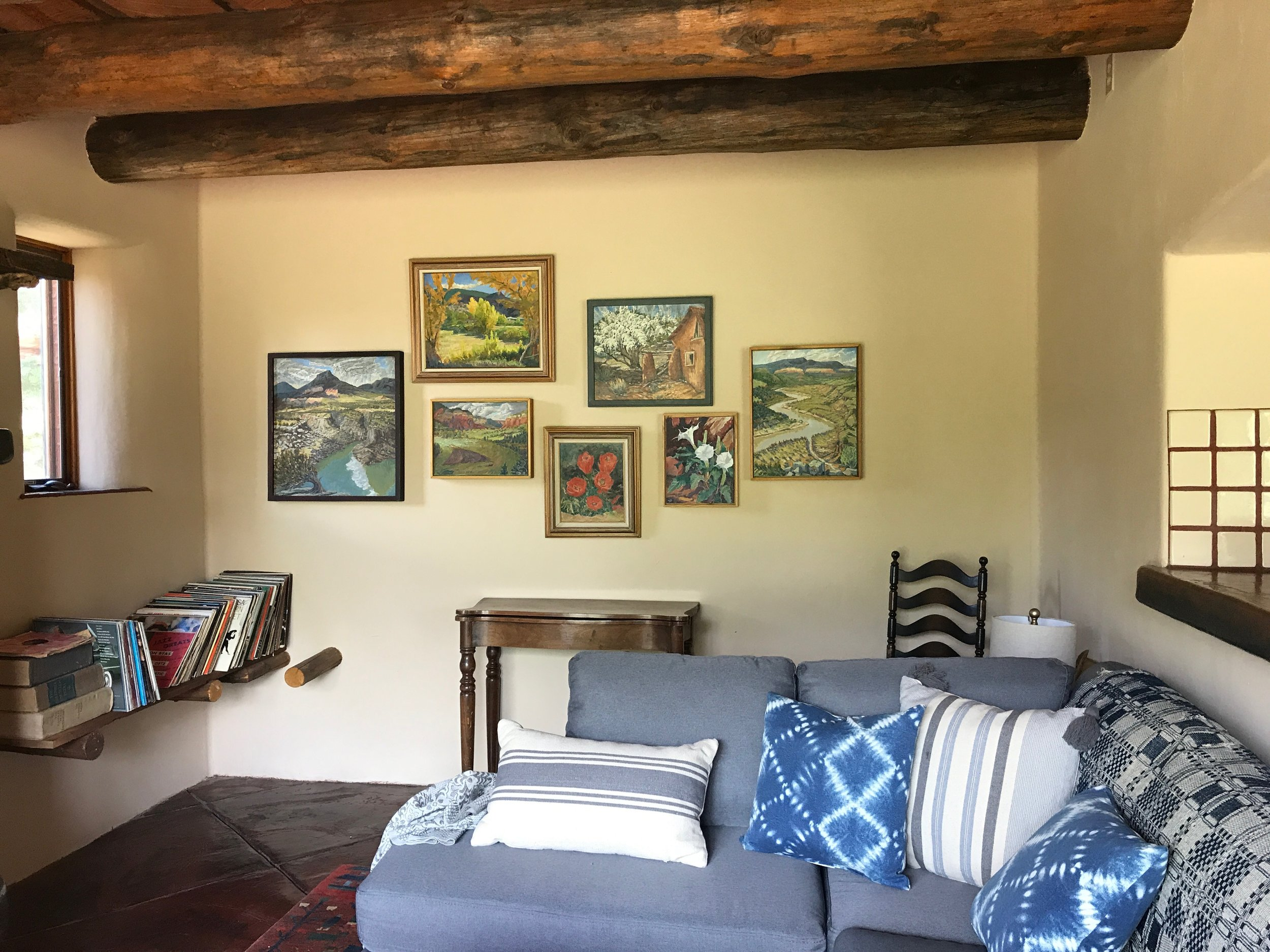 Hanging Don Roach original oil paintings in the Adobe, 2019.