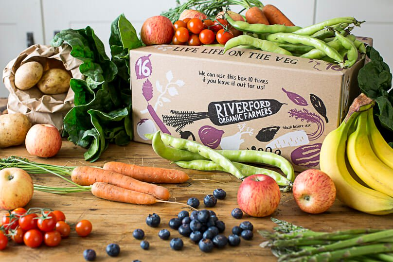 Riverford - PRICE RANGE - £5.25 for a bag of fruit to £30.95 for bumper fruit box.DELIVERY- free to most of the UK.PACKAGING-Riverford have pledged that by the end of 2020, their veg will be 100% plastic free. Presently the boxes are delivered in recycled cardboard boxes that are collected from customers to use again for up to 10 times. Where extra packaging is absolutely necessary, they choose the most sustainable solutions that fit the product's needs such as compostable pulp punnets and compostable beech nets (a by-product from PEFC-certified sustainable forestry) which can be easily disposed of in your home compost heap or council compost bin.ALSO - All produce is organic and they offer a UK veg box if you only want local seasonal produce. They use the highest spec vans, carefully plan routes and train the drivers so that vehicles run as fuel efficiently as possible.