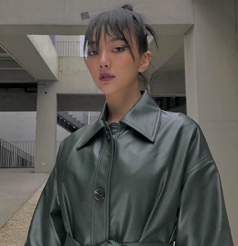 @wenxin.hsieh wearing our green faux leather jacket