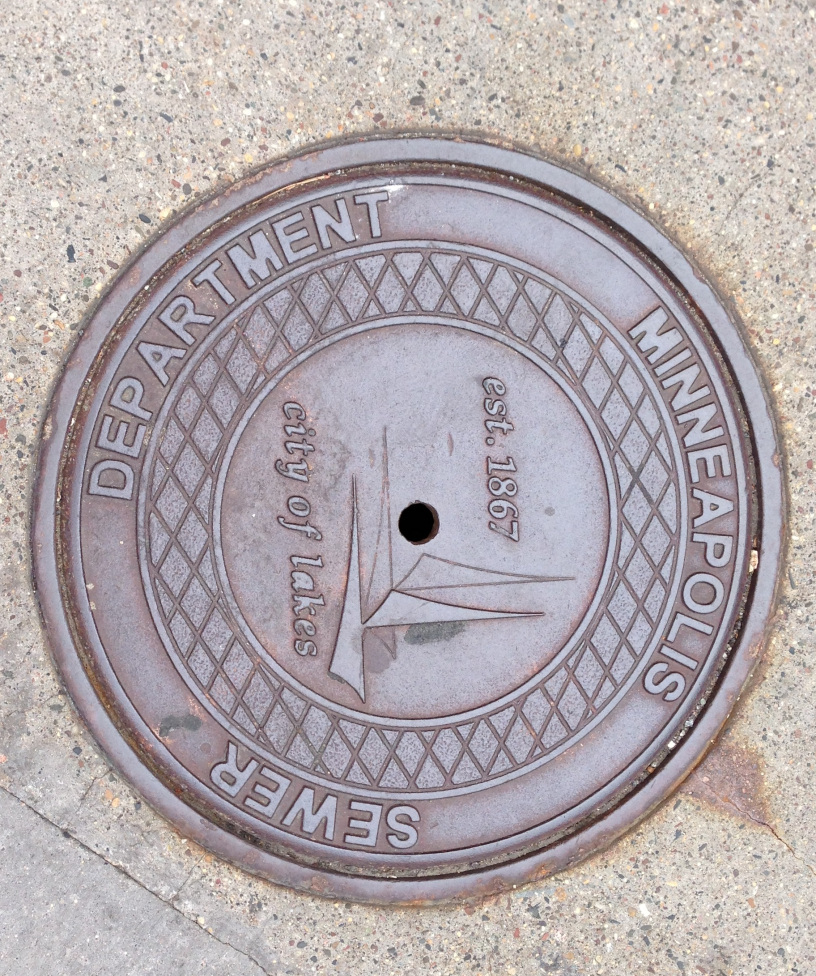 Manhole Entrance - City of Minneapolis Public Works Surface Water and Sewers Division - Do you know where the water from your toilets and sink go? The City of Minneapolis will open a sewer manhole and set up a closed-circuit televising truck so you can see the inside of the sewer system and learn all about it! Safety equipment and staff will be on hand.