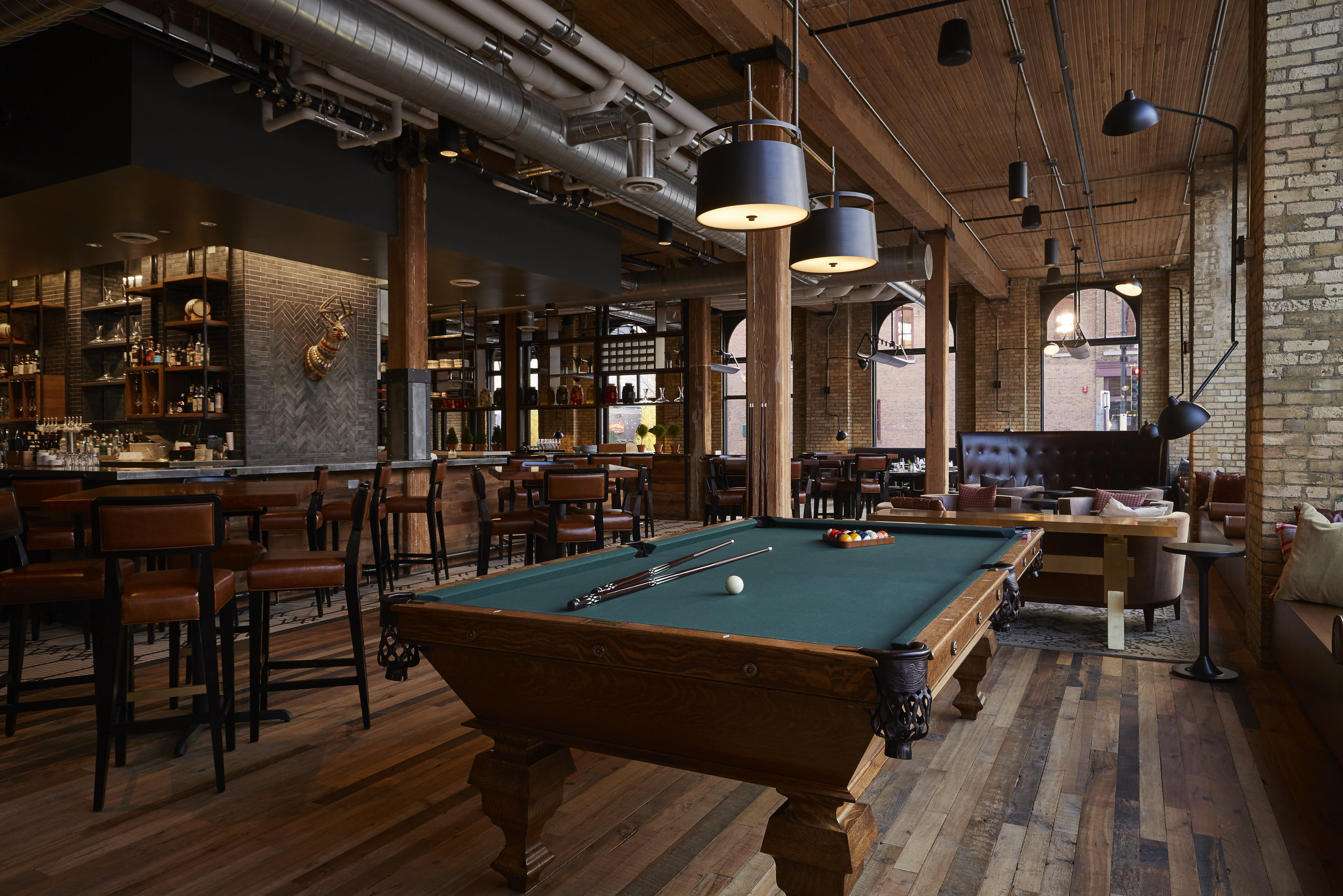 Hewing Hotel - The Hewing Hotel, built in 1897, is a prime example of a brick-and-timber warehouse—trains used to roll directly into the basement! Today, visit to experience the hotel's year-round rooftop, the Library Lounge and its restaurant Tullibee, with cuisine inspired by Minnesota's woods and lakes.