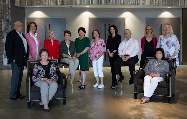 From Left to Right: Bill Landes; Joyce Fletcher; Susan Arnold, Vice Chair; Marsha Biven, Board Chairman; Teresa Gamsky, Secretary; Carol Hughley; Beth Overbey, CPA Treasurer; Fran Scott; Molly Rutherford, Medical Director; Odell Compton;  Seated: Sandy Perry; Janet Warren, Executive Director  Not Pictured: Jennifer Brown, Steve Meacham, Nathan Wilson
