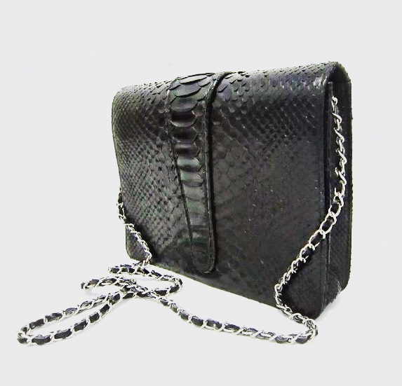 Some things in life are very simple and some things require an EXTRAVAGANT ☝🏾 touch!♣️♟🎱💣🖤⚫️♠️ . . . . . . SUMMER COLLECTION COMING SOON VISIT www.hayleymadison.com #pythonskin #fannypack #wallet #purse #handbag #ss19 #crossbody #glam #beauty #fashion #style #stylist #nycdesigner #womensfashion #icon #girl #blackownedbusiness #luxury #luxurylifestyle #blackexcellence #essencemag #allblackeverything