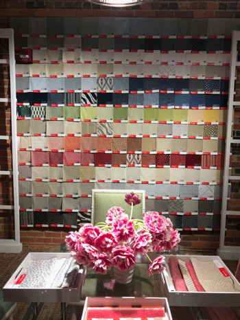 Pink flowers showing off pink fabric swatches at Thibaut
