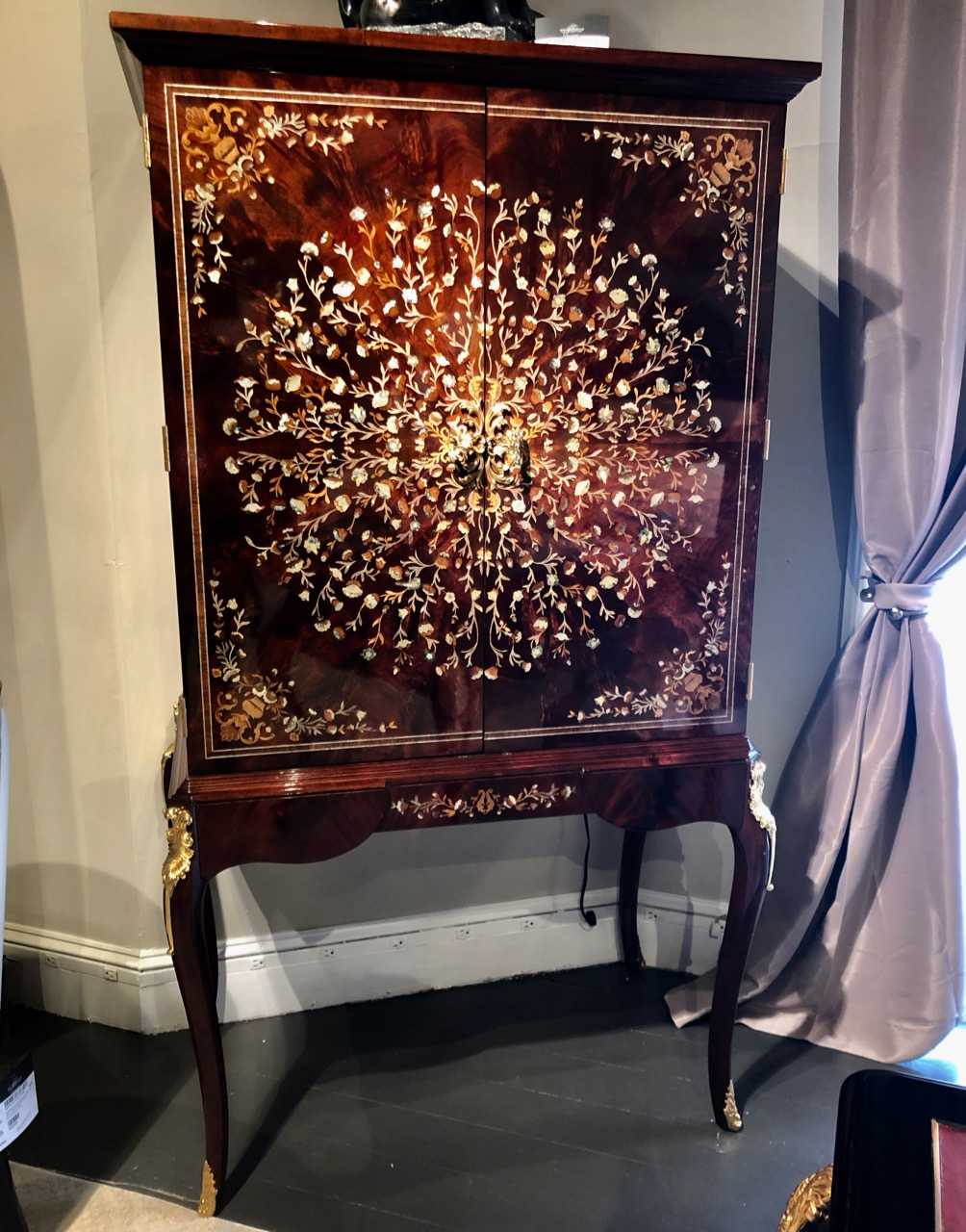 This cabinet from Jonathan Charles is fit for a king!