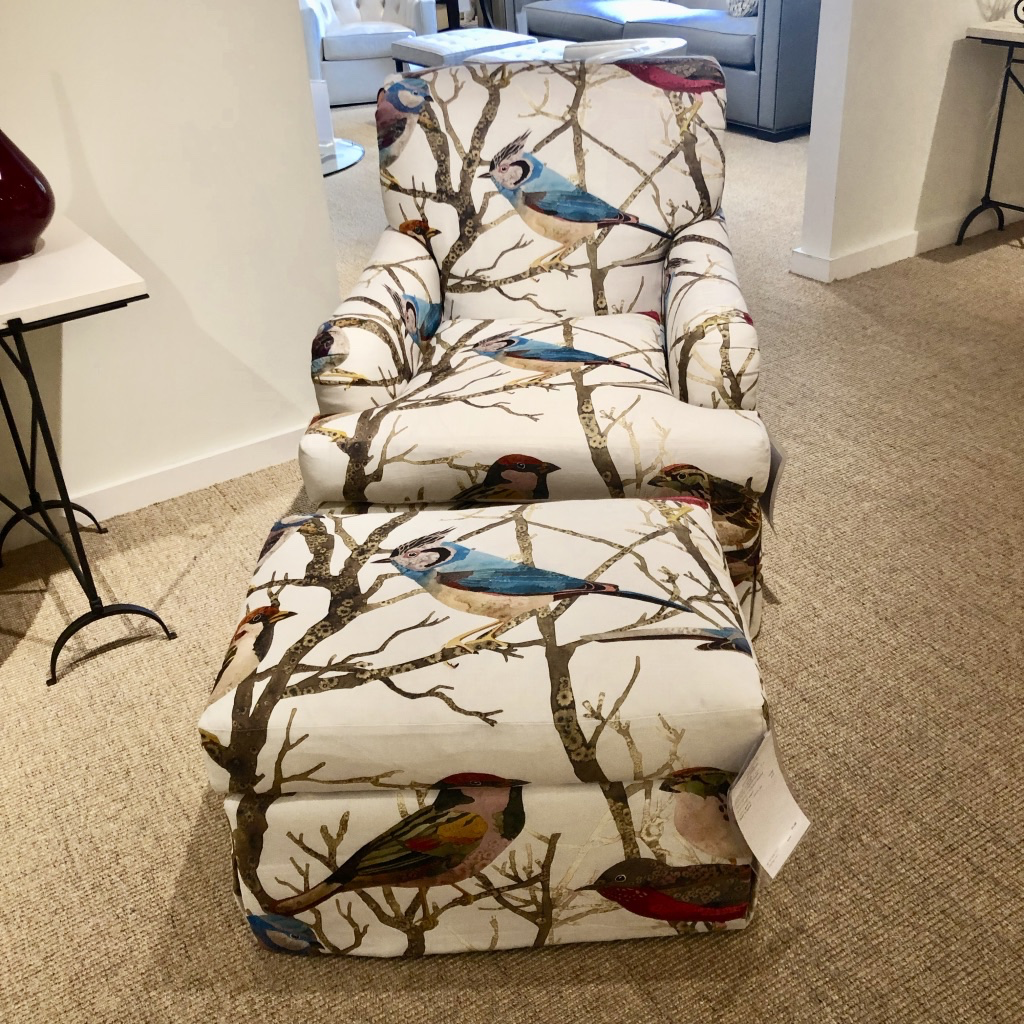 The Pearson showroom was not shy when upholstering this lounge chair and ottoman in oversized bird print fabric!