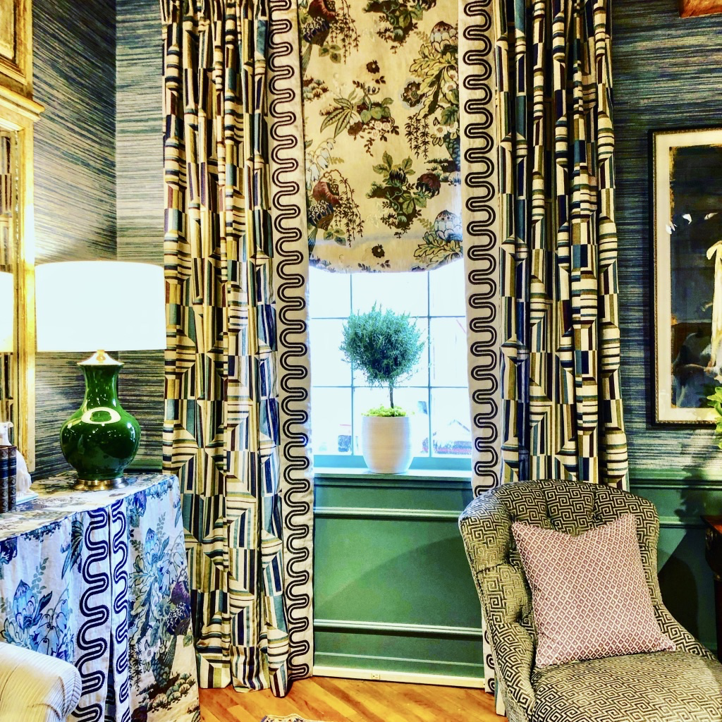 This Thibaut showroom vignette dressed in greens and purples.