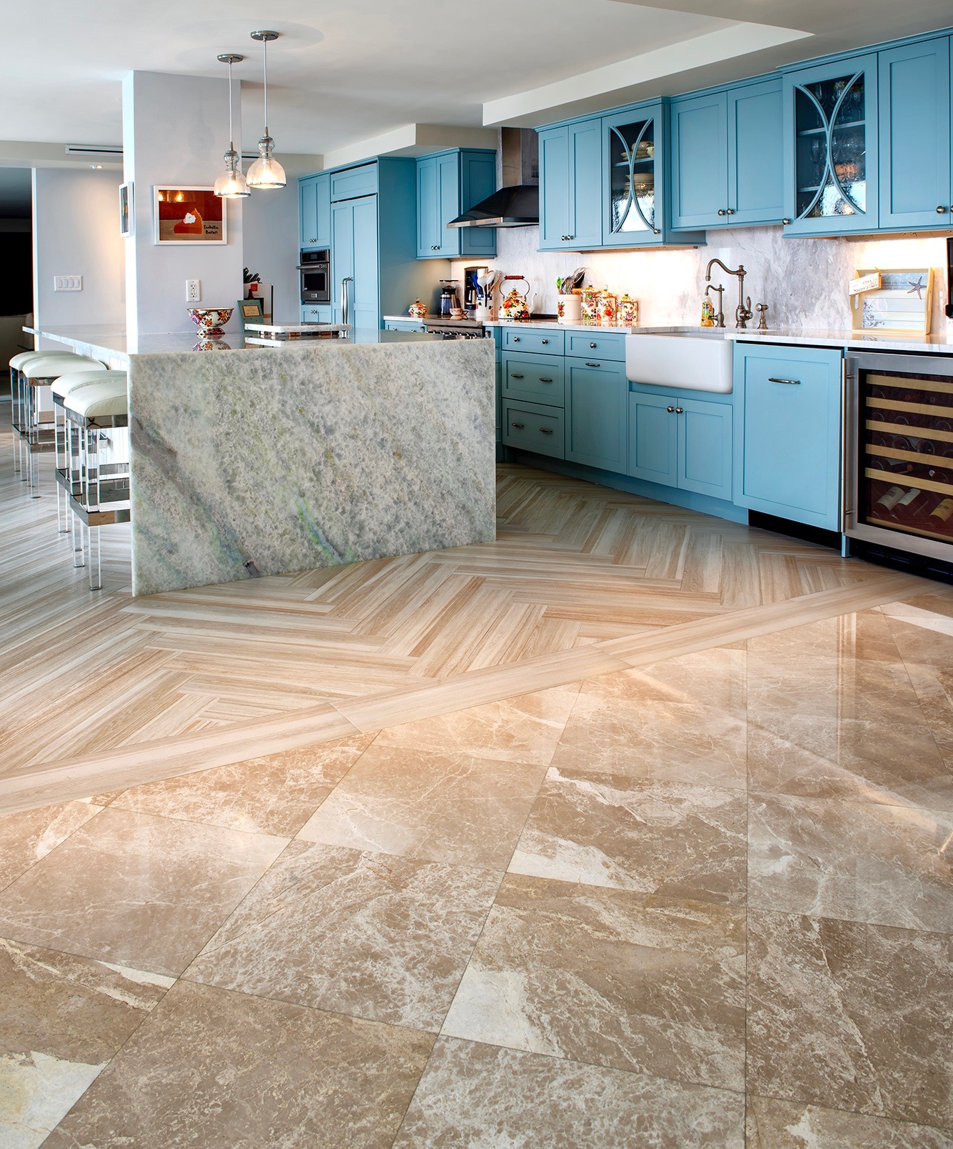New large format square marble tiles flow into the sand-colored plank floor tiles.
