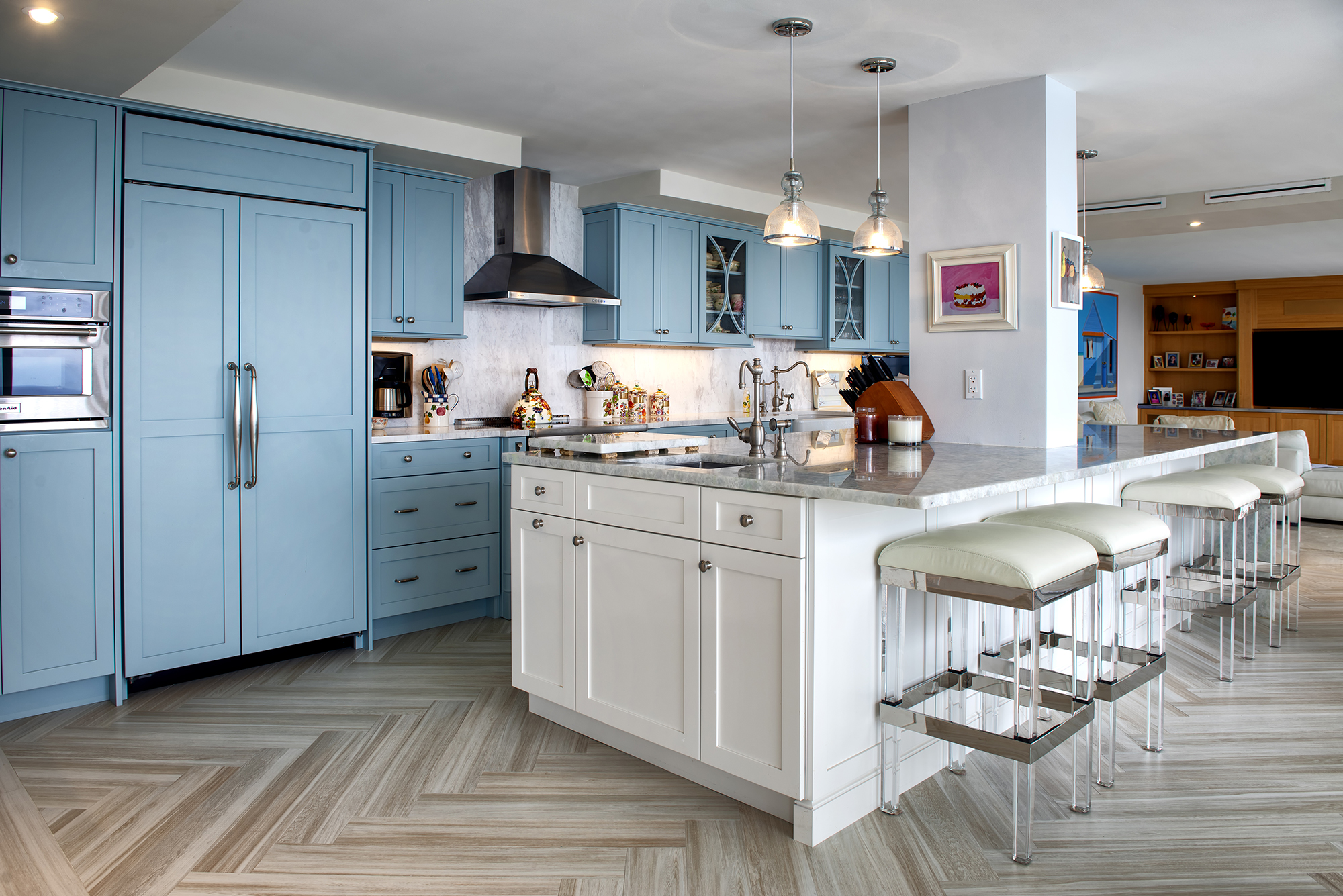 Wood-Mode Oceanside blue cabinets with the herringbone pattern plank flooring tile.