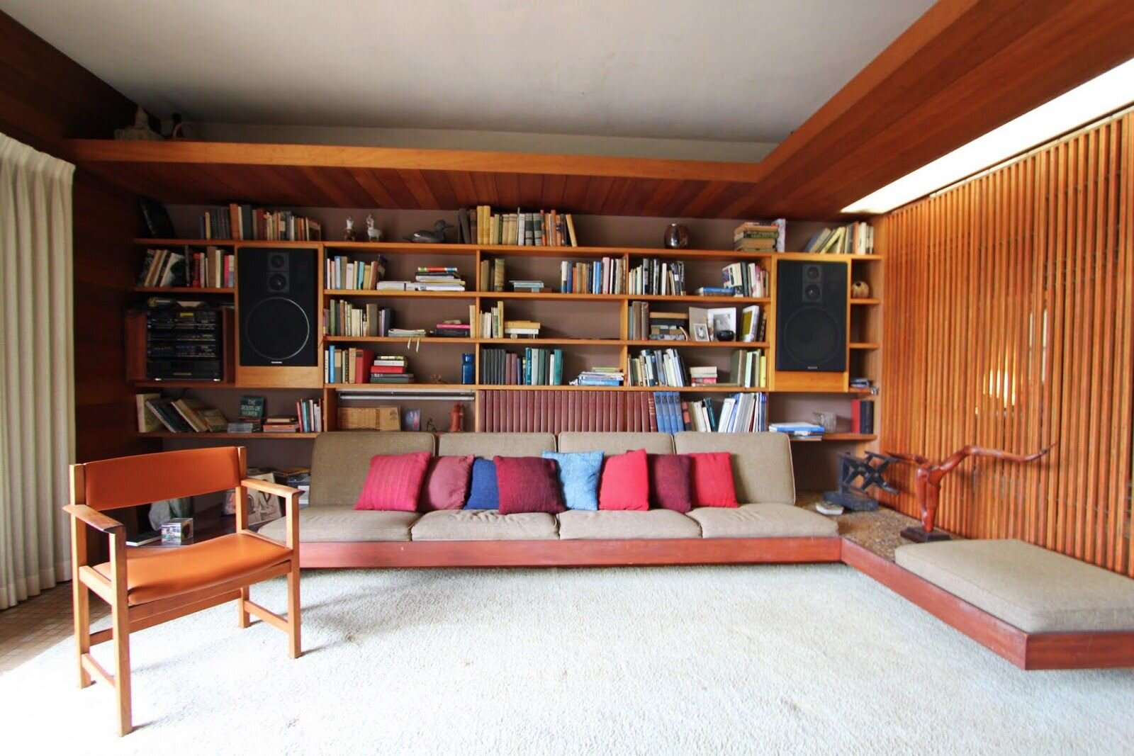 Bookcase design with built-in sectional  sofa .