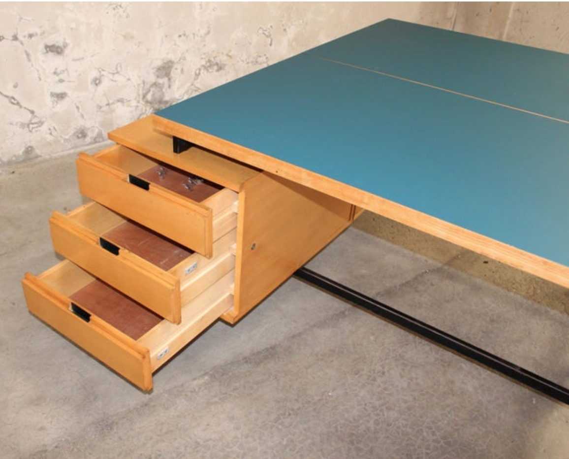 Close up view of desk drawers and Formica tabletop.