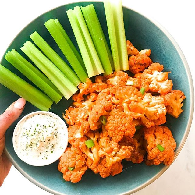 I just got a new air fryer in the mail and I am already obsessed! 🙌🙌 How did I wait this long to get one?! My first test dish is Two Ingredient Keto Buffalo Cauliflower 🔥🔥 All you have to do is cut your cauliflower into florets, coat with @thenewprimal Buffalo Sauce, and pop in the air fryer @ 325F for 10 minutes. That's it! Pair with some celery sticks and my short cut ranch dip (Creme Fraiche mixed with @traderjoes Onion Salt and some black pepper). This is the perfect keto crowd pleaser appetizer! 💯💯 What else should I make with my air fryer?!!