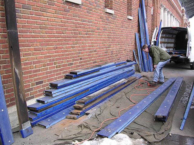 The founder of Michigan Stadium Products salvaging bench seats at the Big House in March 2005.