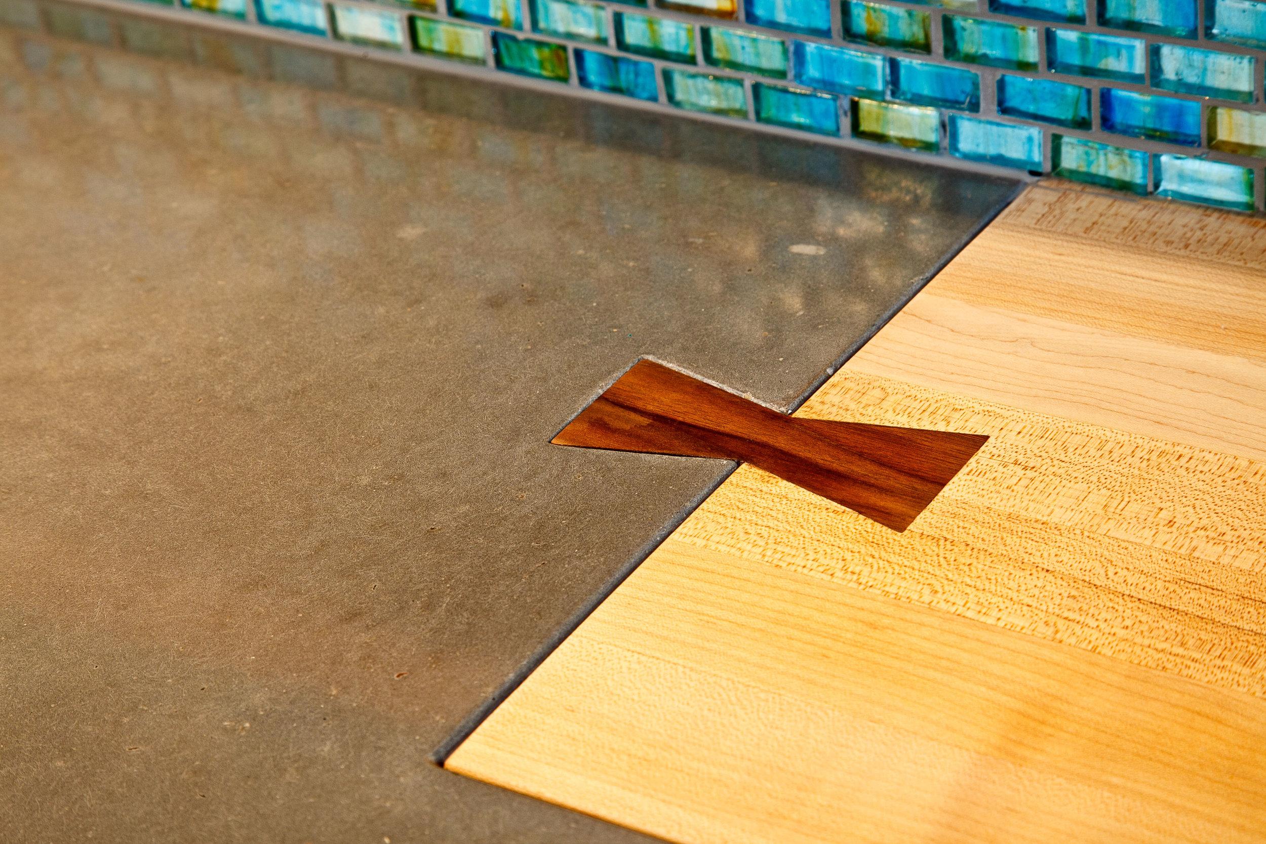 ECC Warm Grey Concrete Countertop and Wood Bowtie Seam Detail.jpg