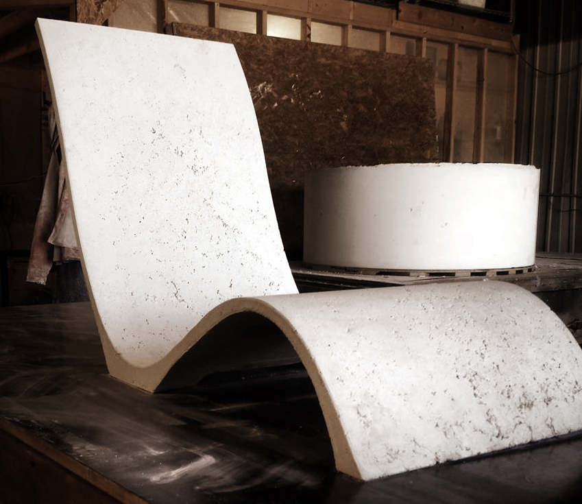 Concrete Lounge Chair with Firepit behind.jpg
