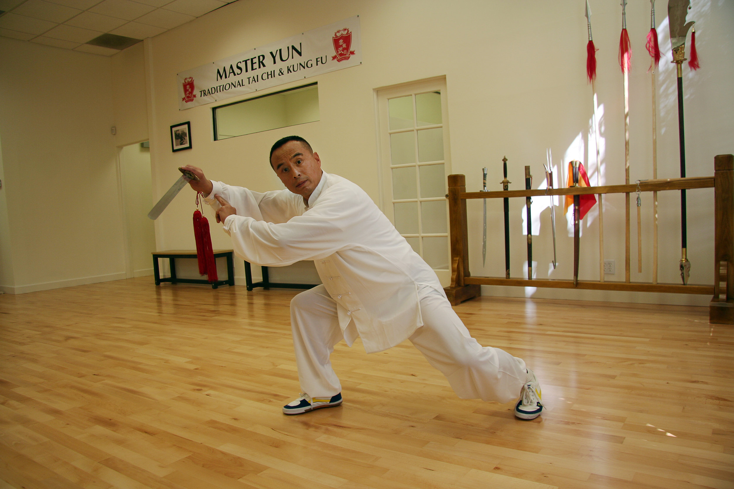 Master Yun poses with the Qing Ping Sword in our new studio in Santa Barbara.