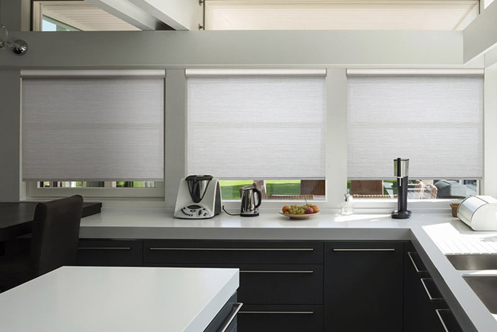 Roller shades are a clean, contemporary window treatment. Available in many fabrics, colours and opacities with options such as cordless and motorized.