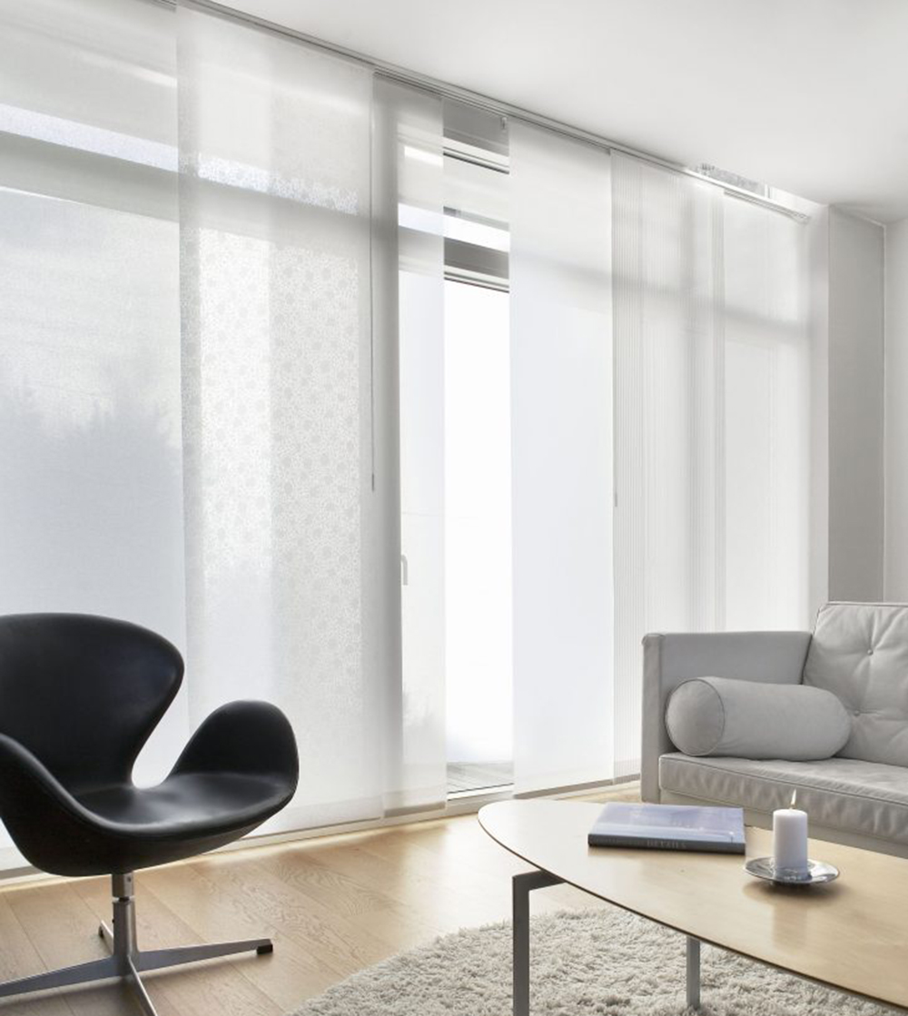 Panel track shades are the perfect solution for large windows, patio doors and room dividers. Options include right, left or centre opening.