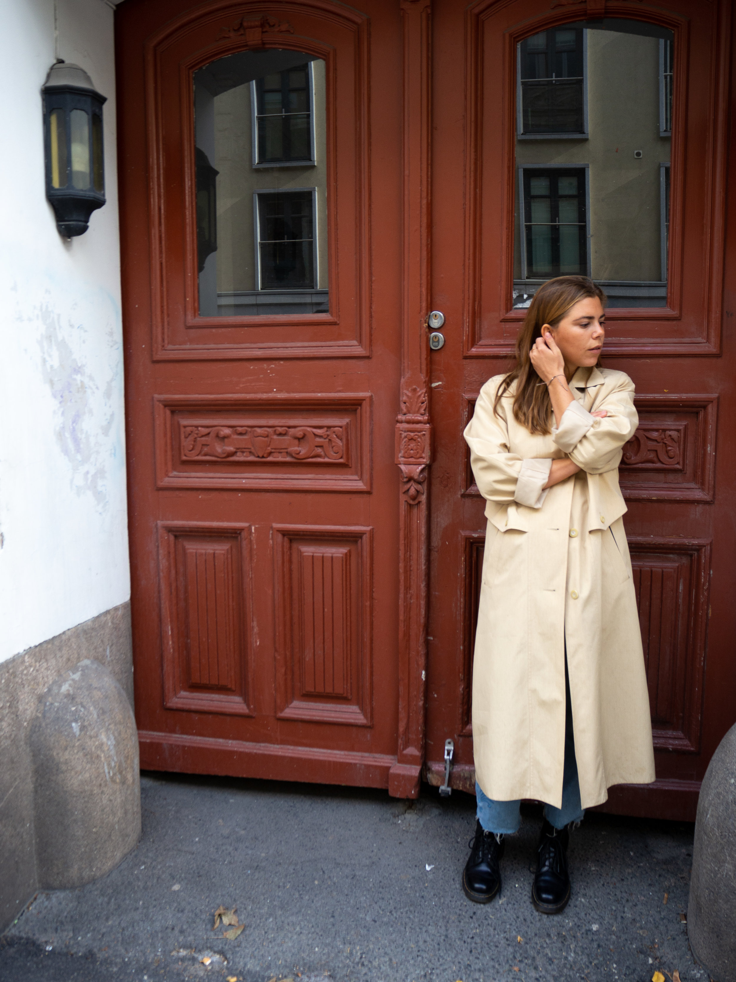Anette in a classic, timeless trenchcoat.