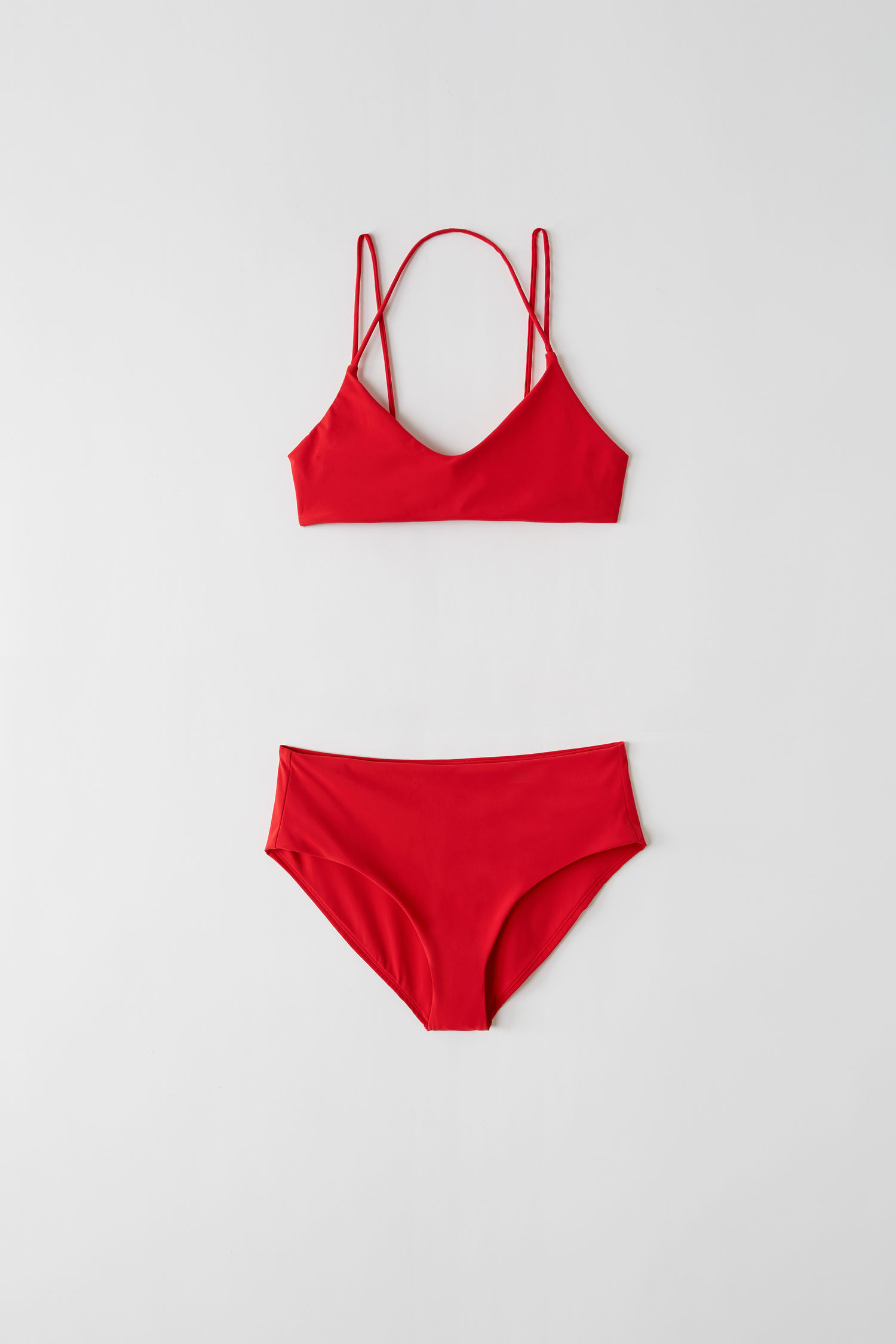This red bikini from Acne is just a must this spring / summer! Buy it  here !   Photo by Acne