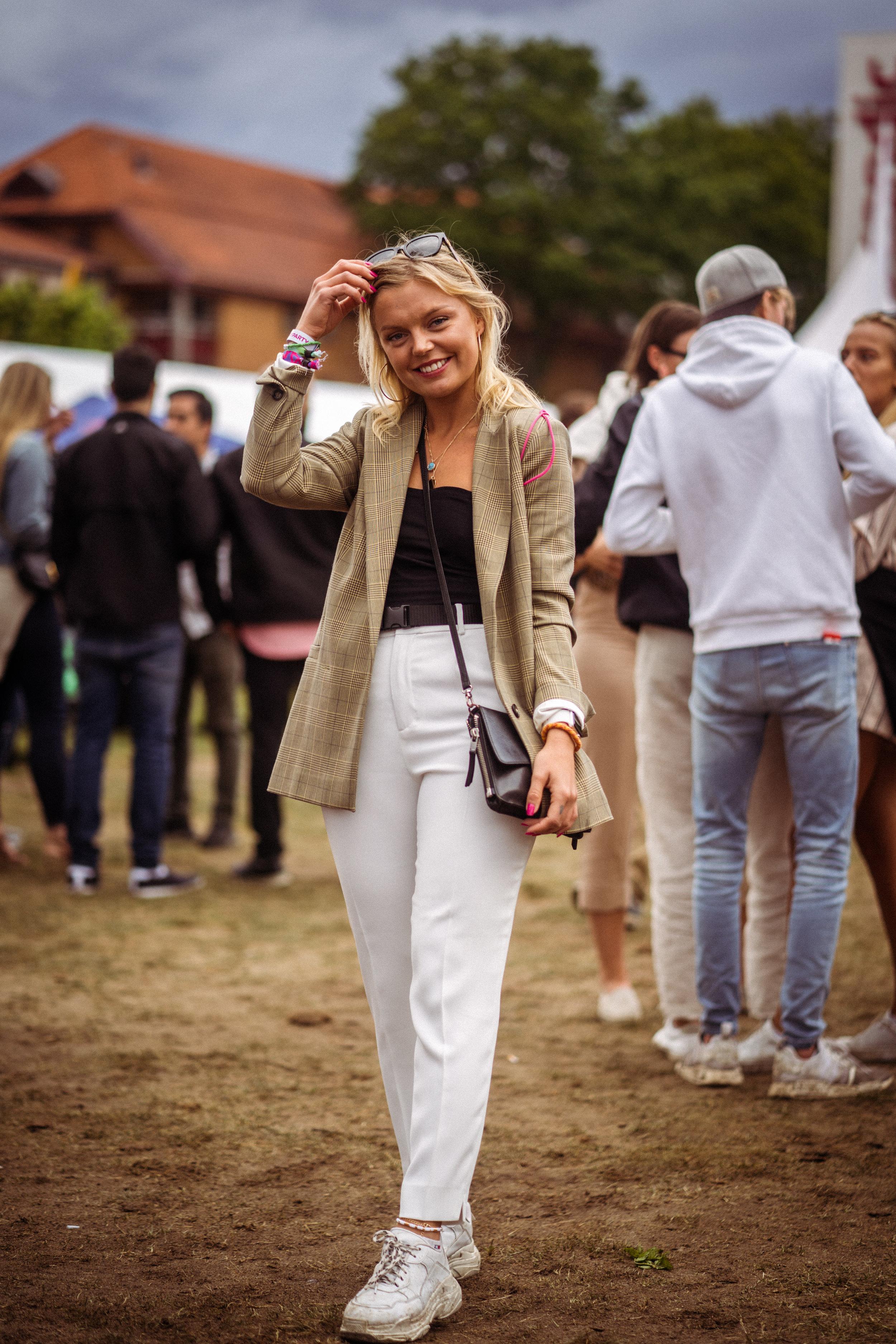 Kristina Kvalheim    taking the timeless blazer to the festival. Photo: Sander Berhus / Estér Magazine.