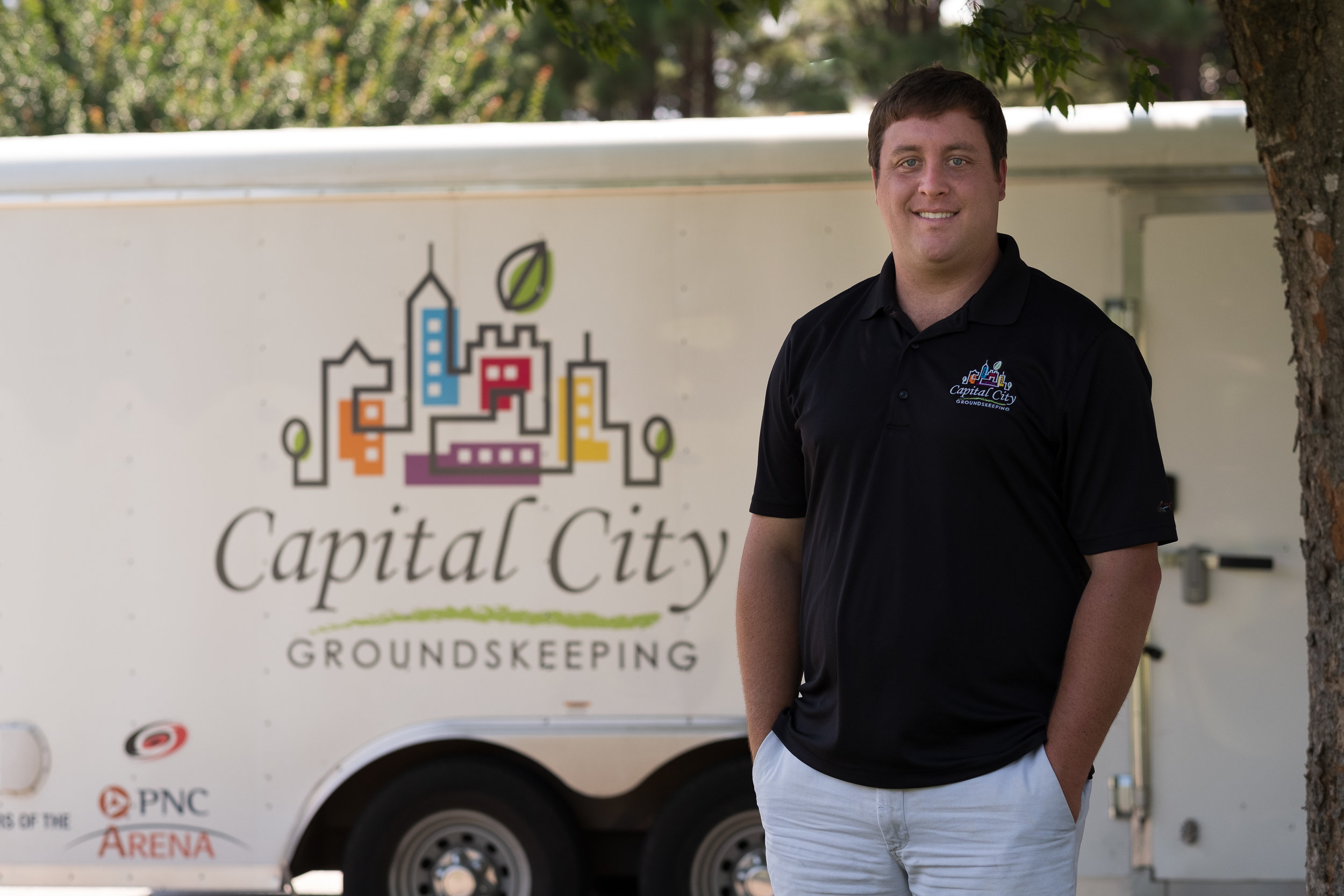 """Ryan Walsh, Founder & Owner - Capital City Groundskeeping is a Raleigh-based company that operates six days a week throughout Wake County and beyond with up to 10 people. But that wasn't always the case.Founder and owner Ryan Walsh started mowing lawns while still in high school back in 2000. The young entrepreneur says he started because he """"wanted to work, make money, and enjoy the independence it brought"""". At NCSU he majored in Turf and Grass Science which boosted his knowledge in landscaping and where he learned both the functional and ornamental characteristics of different grasses. Ryan worked through college expanding his portfolio. He graduated in 2013 and then the company, which he self-financed, really started growing.Even though Ryan had the support of his parents, he spent his days working with grass and mulch and his evenings with paperwork. Through a family connection, Ryan met Patricia Villa of CSFAS and things started to turn around.Patricia and her team put all his accounts in order, brought his QuickBooks file up to current and corrected the tax errors they found. They've been working together for three years and Ryan says, """"the CSFAS team is trustworthy and fair.""""The team provides monthly financial reports and forecasting, help manage payroll and handle all annual tax filings. Ryan says that having """"accurate financial records allows for good decision-making on equipment purchases, hiring, and expansion."""" All this has freed up at least 10 hours a week for Ryan allowing him to focus on bidding on new contracts and managing the business.Since its beginning 20 years ago, Walsh and his team have expanded from mowing lawns to providing all maintenance services including hedge trimming, plant installs, sodding, some flowerbed and mulch installations, for mostly commercial businesses. Ryan counts the PNC Arena, several homeowners associations, and the largest cemetery in Raleigh as some of his clients.His goal for the next year is to grow the company by b"""