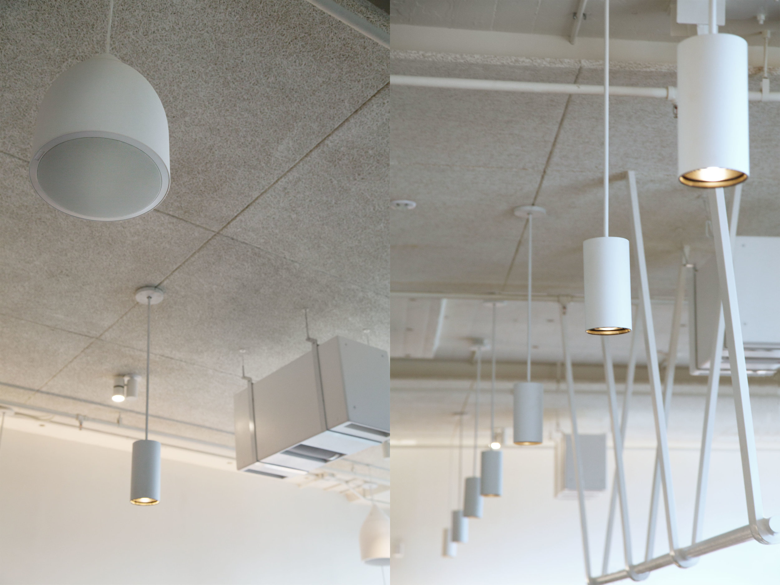 Pendant speakers, custom hung subwoofers, and lighting pendants neatly pierce through a Tectum-paneled acoustic ceiling.