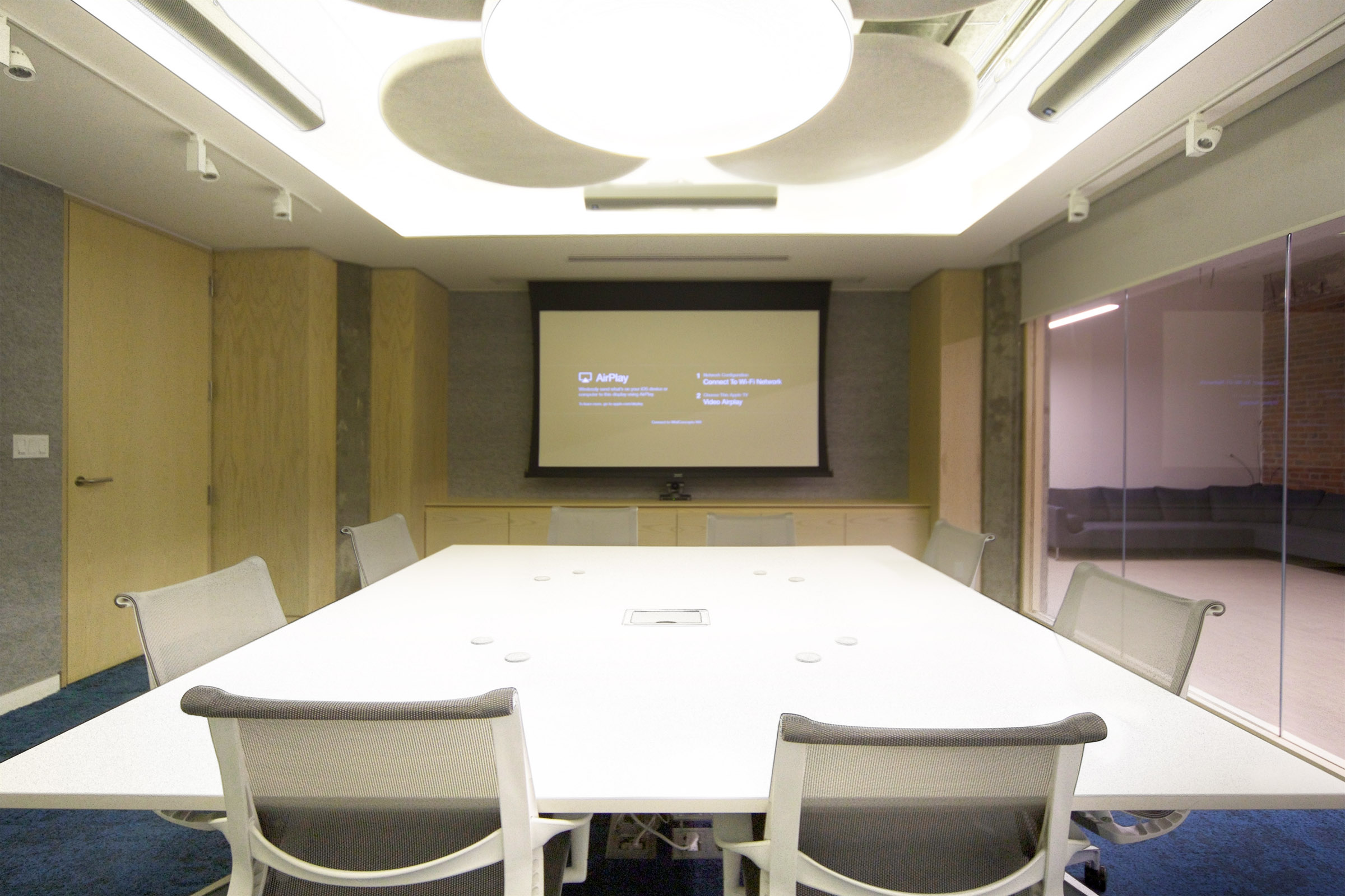 """Several connection options, including wireless video transmission via Airplay, allow guests and staff alike to display what they want, as the need to on either the 50"""" TV, or the 9'-foot motorized projection screen."""