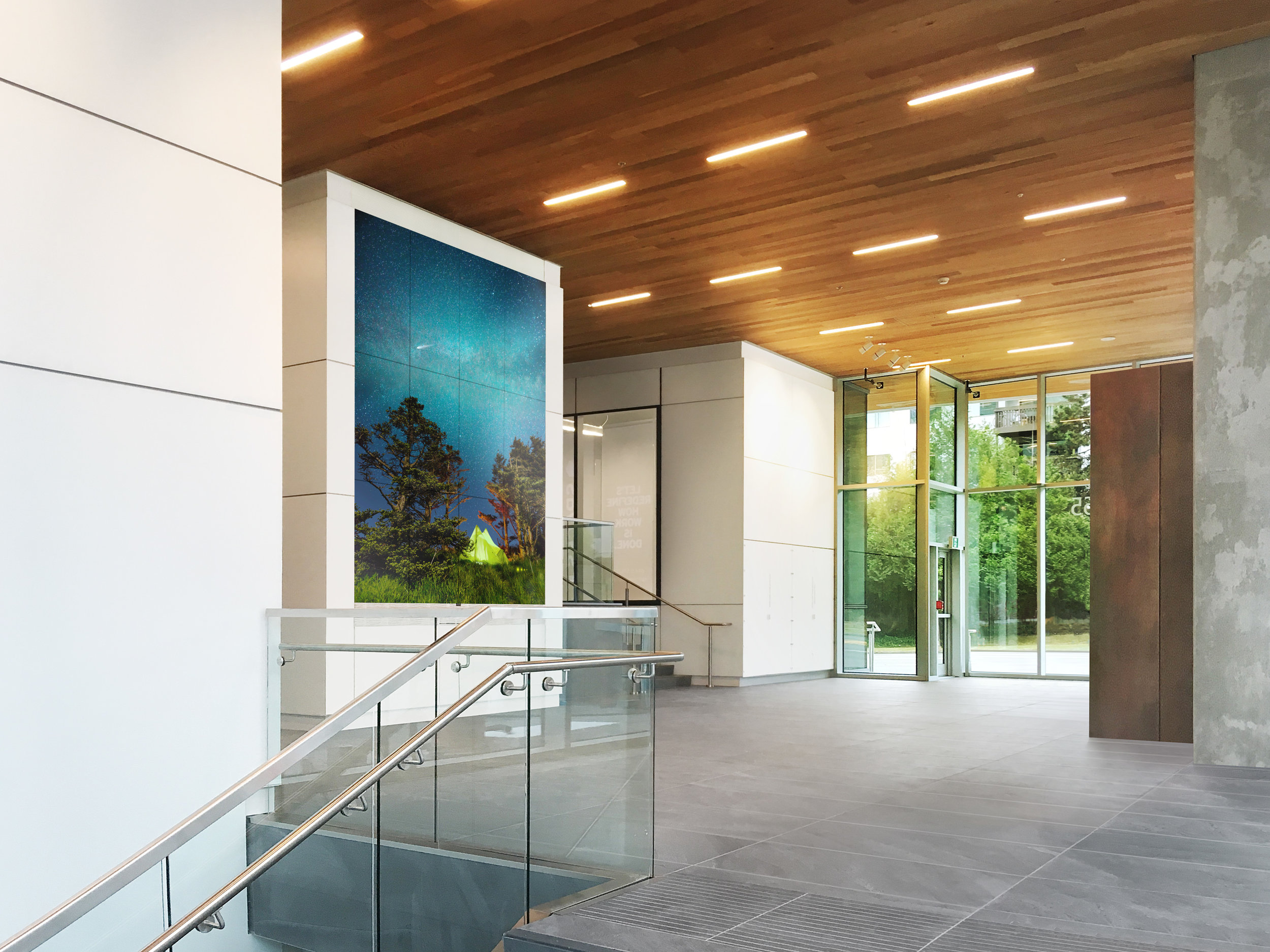 The Grand lobby of 569 Great Northern Way, featuring the 16-foot monumental video wall.
