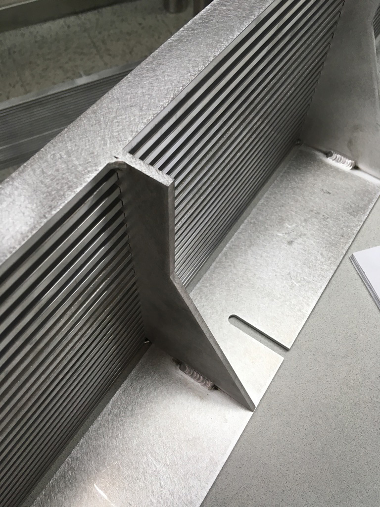 We generally design and fabricate custom vent grilles for our video walls to ensure adequate air circulation, and to optimize the positioning of the screens relative to the surrounding sight lines. These grilles are ready for powder-coating.