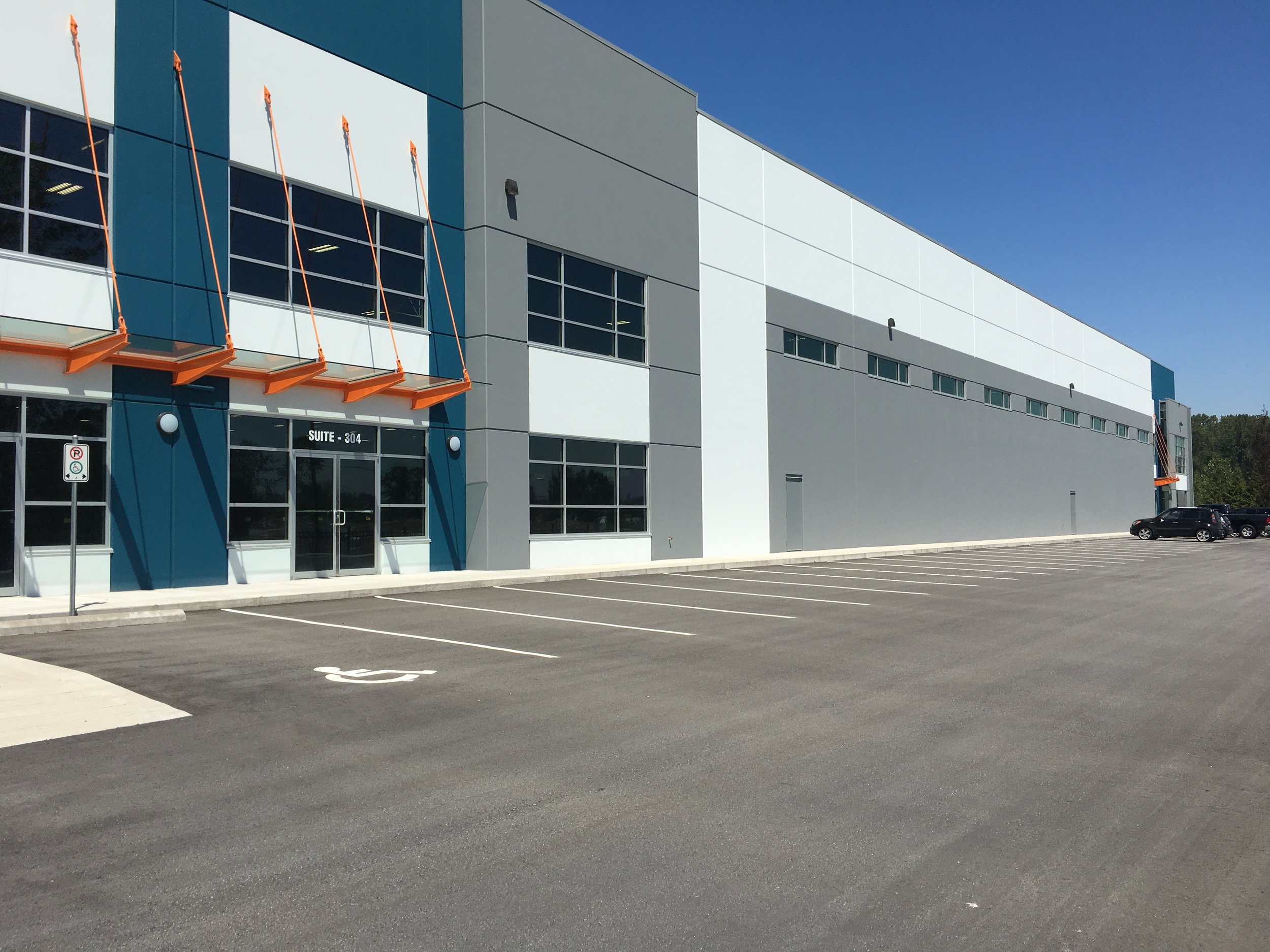 The facility is a brand new, 250,000 square foot warehouse, with a stylish facade and plenty of service bays at the rear.