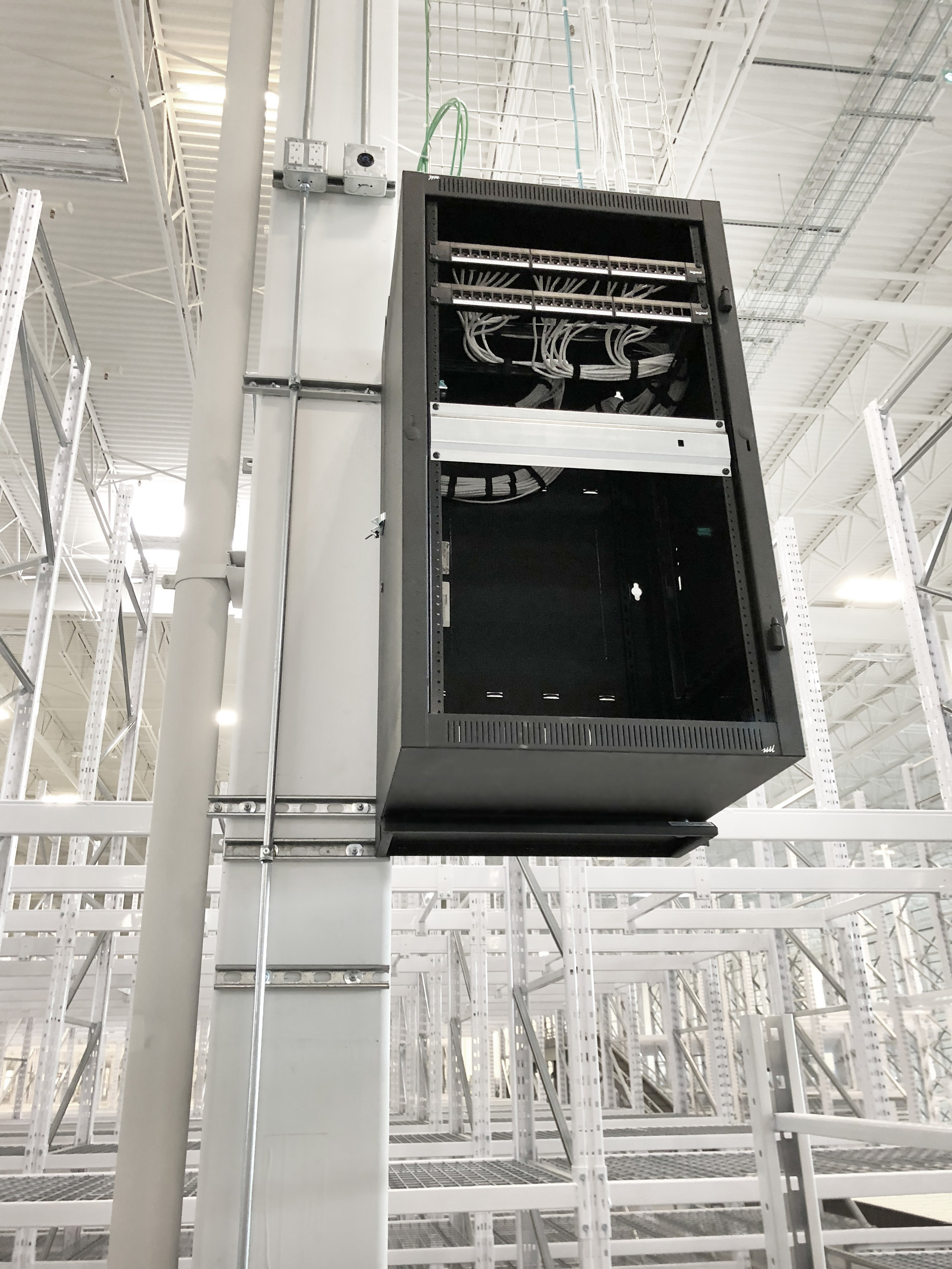 This rack has the loomed cable fed into it, and network runs punched down to patch panels.