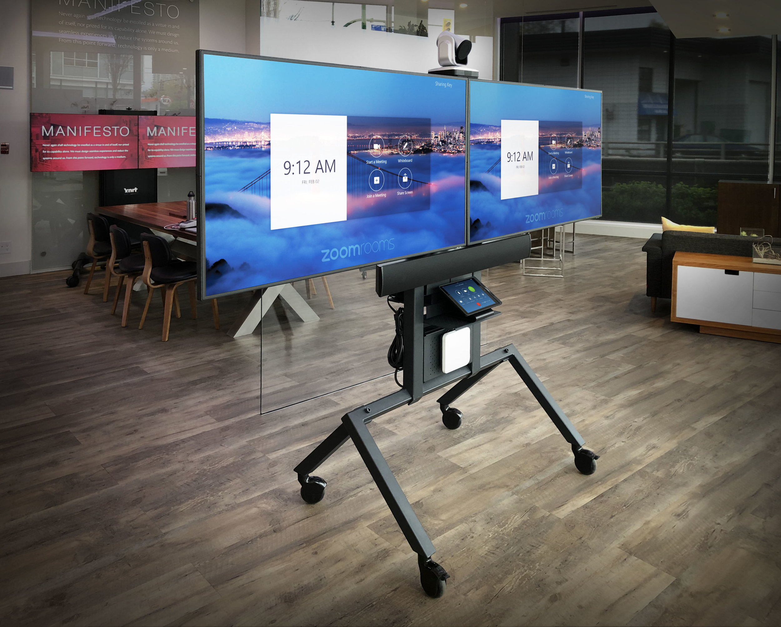 Xprt's Zoom Cart is a mobile communications hub with an iPad to Run the Zoom Rooms app, controlling a complete, dual-screen, Zoom conferencing experience.