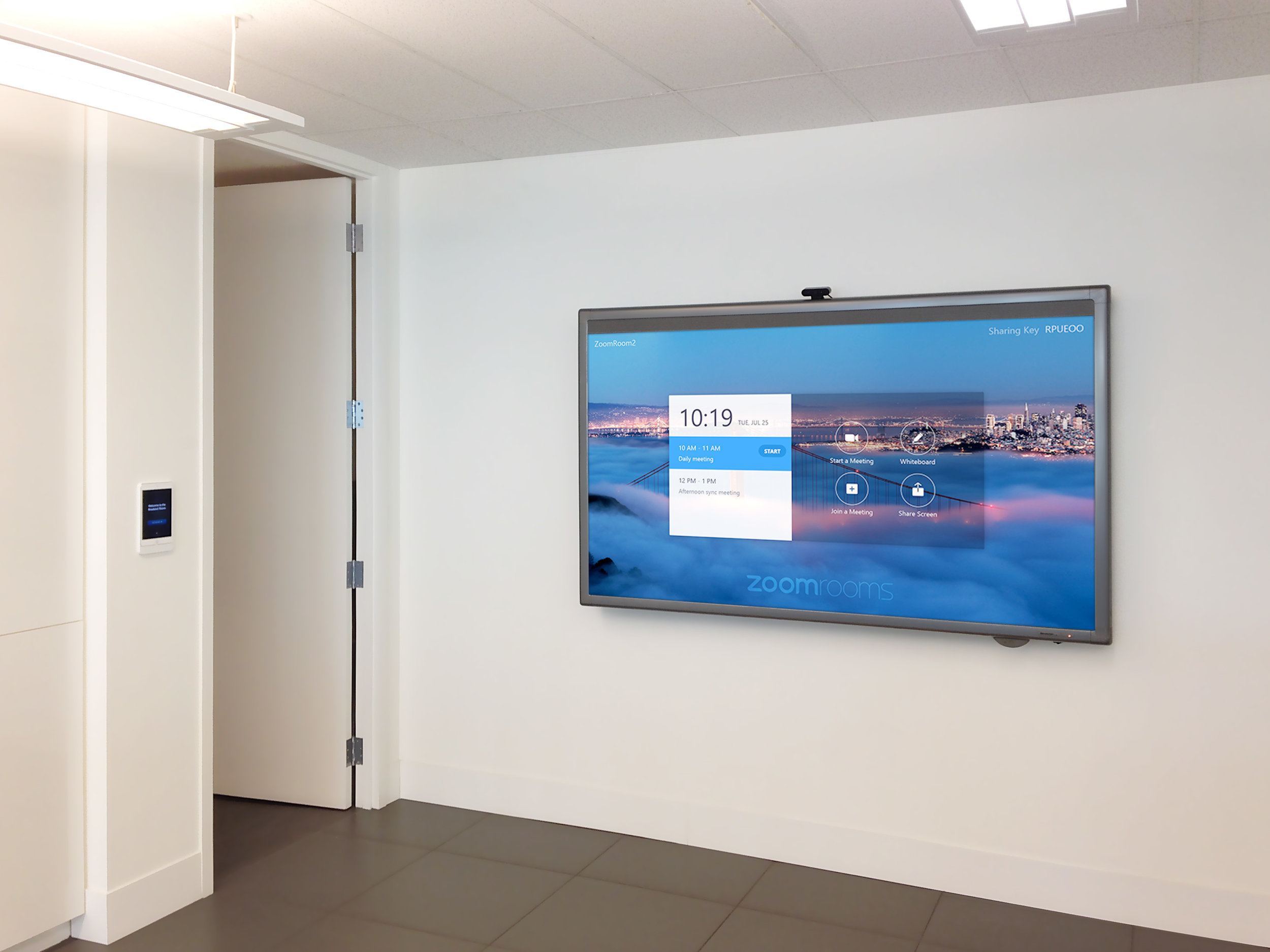Typified by clean walls and neatly organized spaces, this office is adorned with equally tidy AV facilities.
