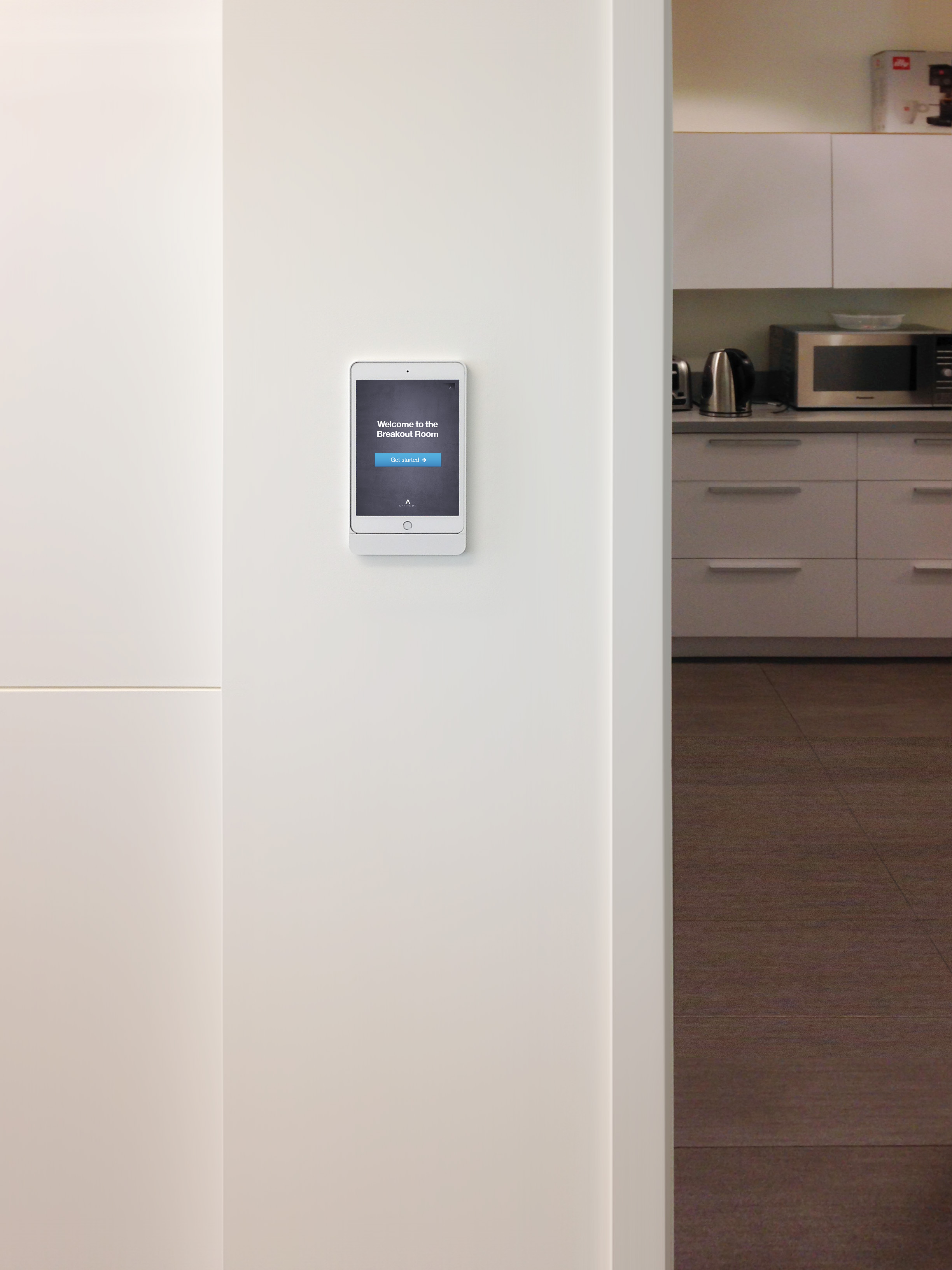 iPads in Basalte Eve® wall mounts greet guests as they enter the various outfitted rooms throughout this space.