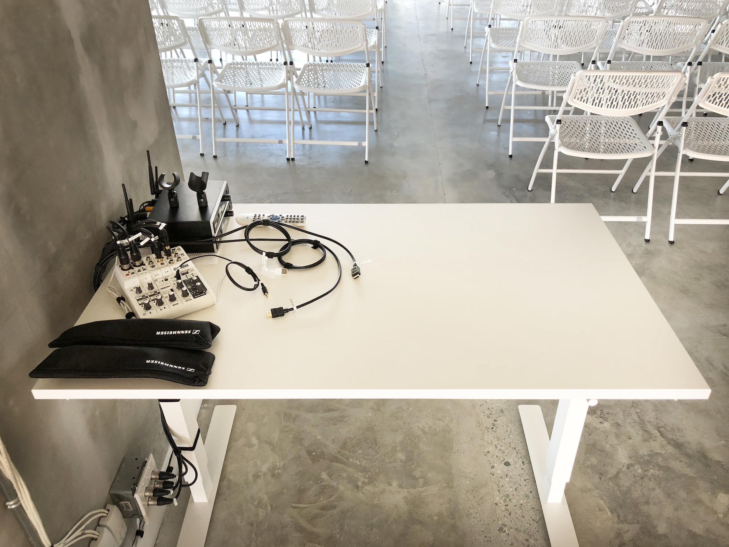 Temporary by nature, the microphones and peripheral equipment for the space is stored on a table at the back of the space, ready for the first gathering.