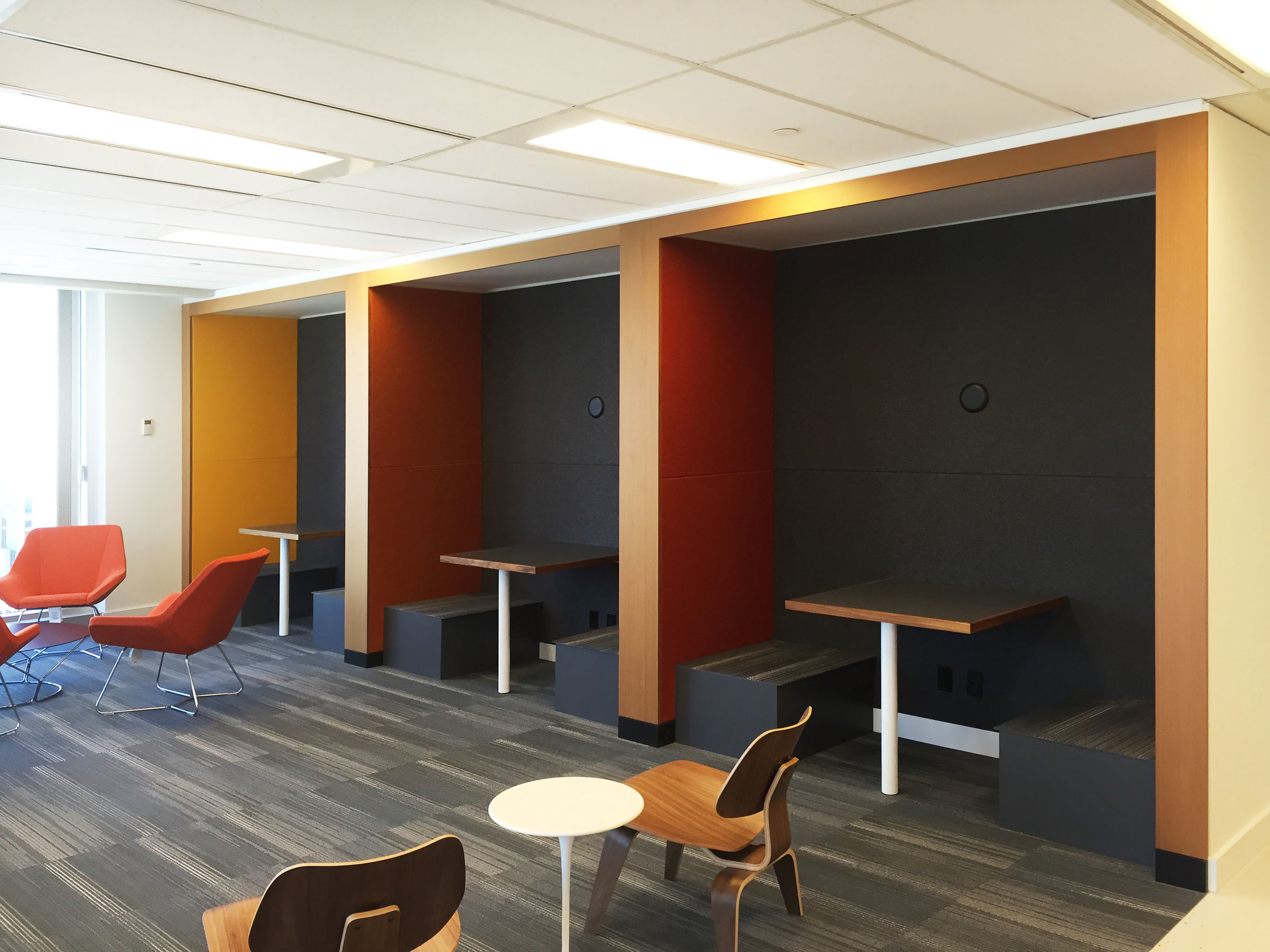 There are many huddle spaces throughout the space, each with power and data. These also double as booths for joining a colleague for a lunch meeting.