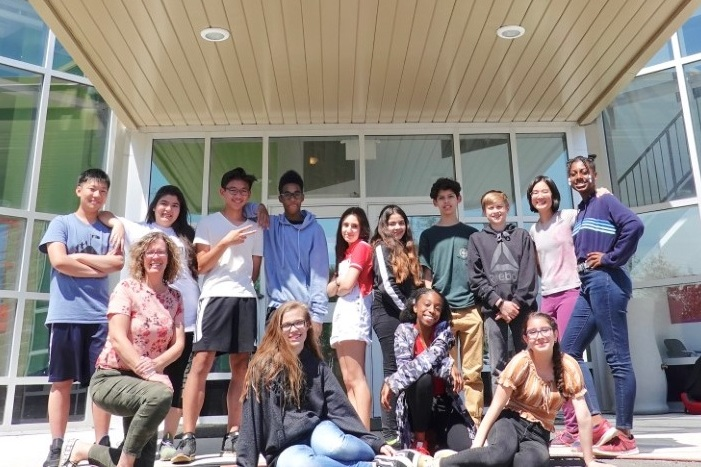 The Grade 8 class poses with Mrs. Barb Ubbens in front of Timothy Christian School, located at 28 Elmhurst Drive in Etobicoke.