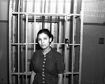 Emma Tenayuca standing inside jail, June, 1937. Photographed in San Antonio, Texas. Courtesy of the Institute of Texan Cultures