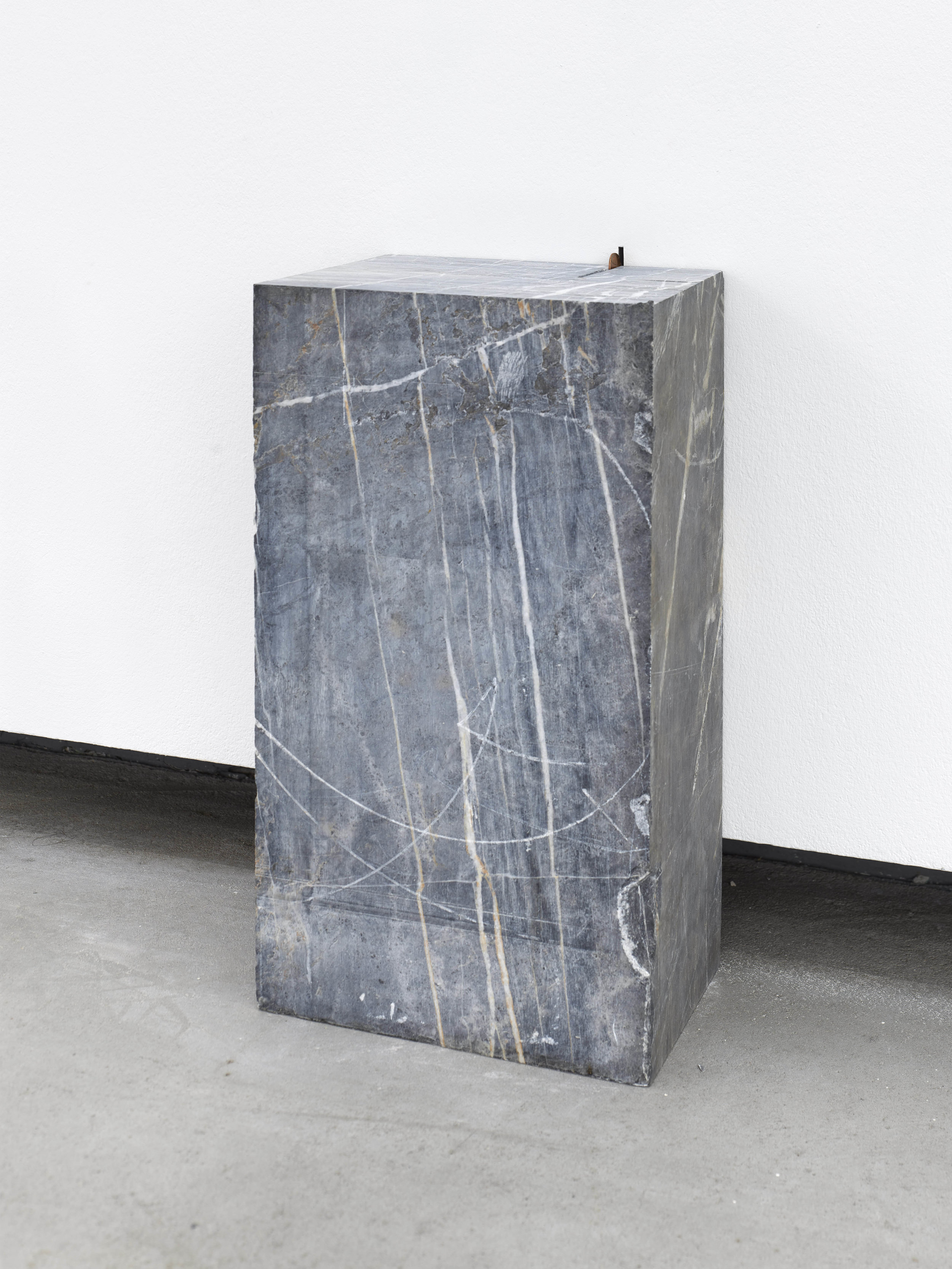Coined Notion,  2016  marble and mis-struck error Lincoln coin  48 x 18 x 23 cm