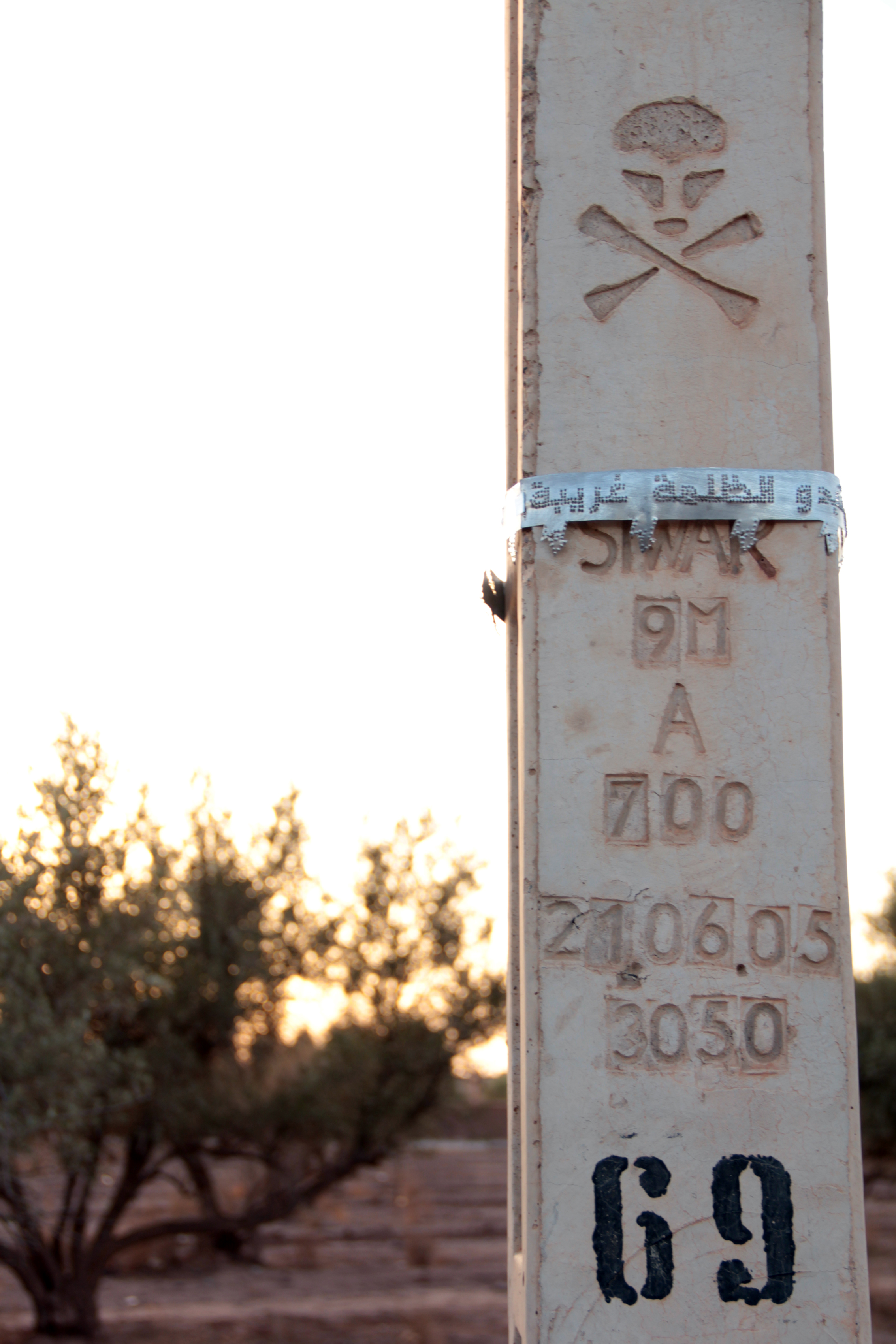 when the lights go out darkness seems strange , 2012   hammered aluminum on concrete electricity poles   Ourika Valley, Marrakech