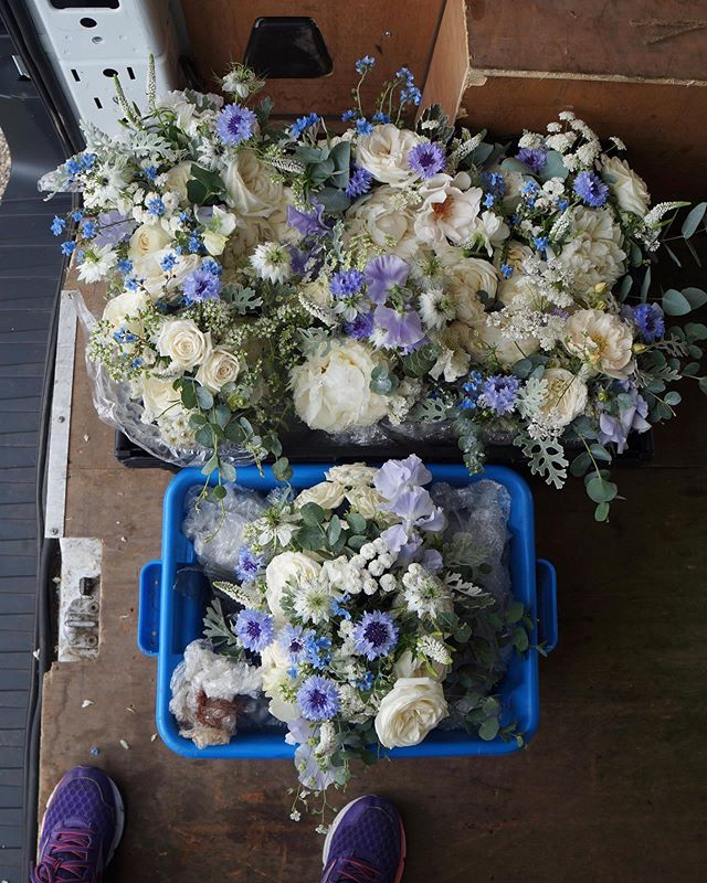 The bouquets sit quietly in the flurry of it all, safely packed up and ready to be transported to their wedding destination 🦋