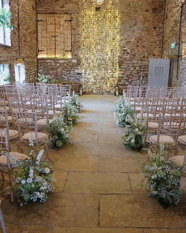 Organic-y aisle arrangements made using primarily British Flowers; ammi, malope, marjoram, larkspur, Roses and thistle.