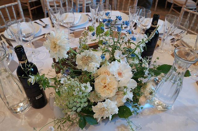 Table arrangements for Maddy and Ross on Saturday. White and green with a pop of blue using an abundance of British flowers from my favourite growers; @flowersbyseason @carolsiddorn and some beautiful English roses from @theyorkshireflowerpatch. A huuuuuge thank you to my wonderful freelancers too, @the_nurtured_stem and @alma_floralstudio, you were fabulous 💫