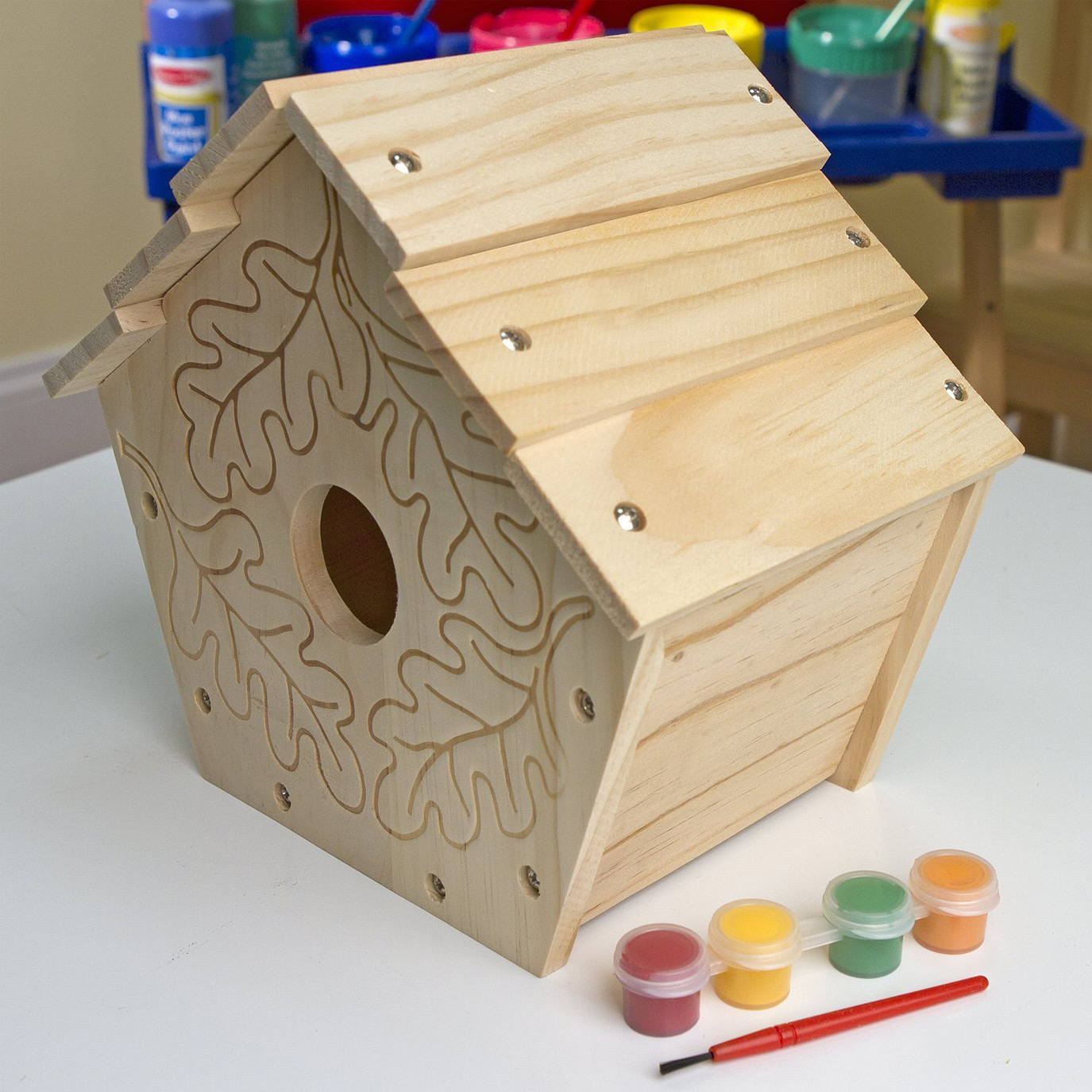 BUILD YOUR OWN WOODEN BIRDHOUSE (R175)   Encourage a love of birds and nature with this easy to assemble birdhouse for you and your child to assemble and decorate. Your feathered neighbours will love their home-tweet-home!  This great 'build your own' set contains: wooden panels, screws, 4 pots of paint and a paint brush.  This construction craft activity promotes fine motor skills, hand-eye coordination, problem solving, and encourages artistic ability as well as an appreciation for nature.  Suitable for ages 5 years and older.